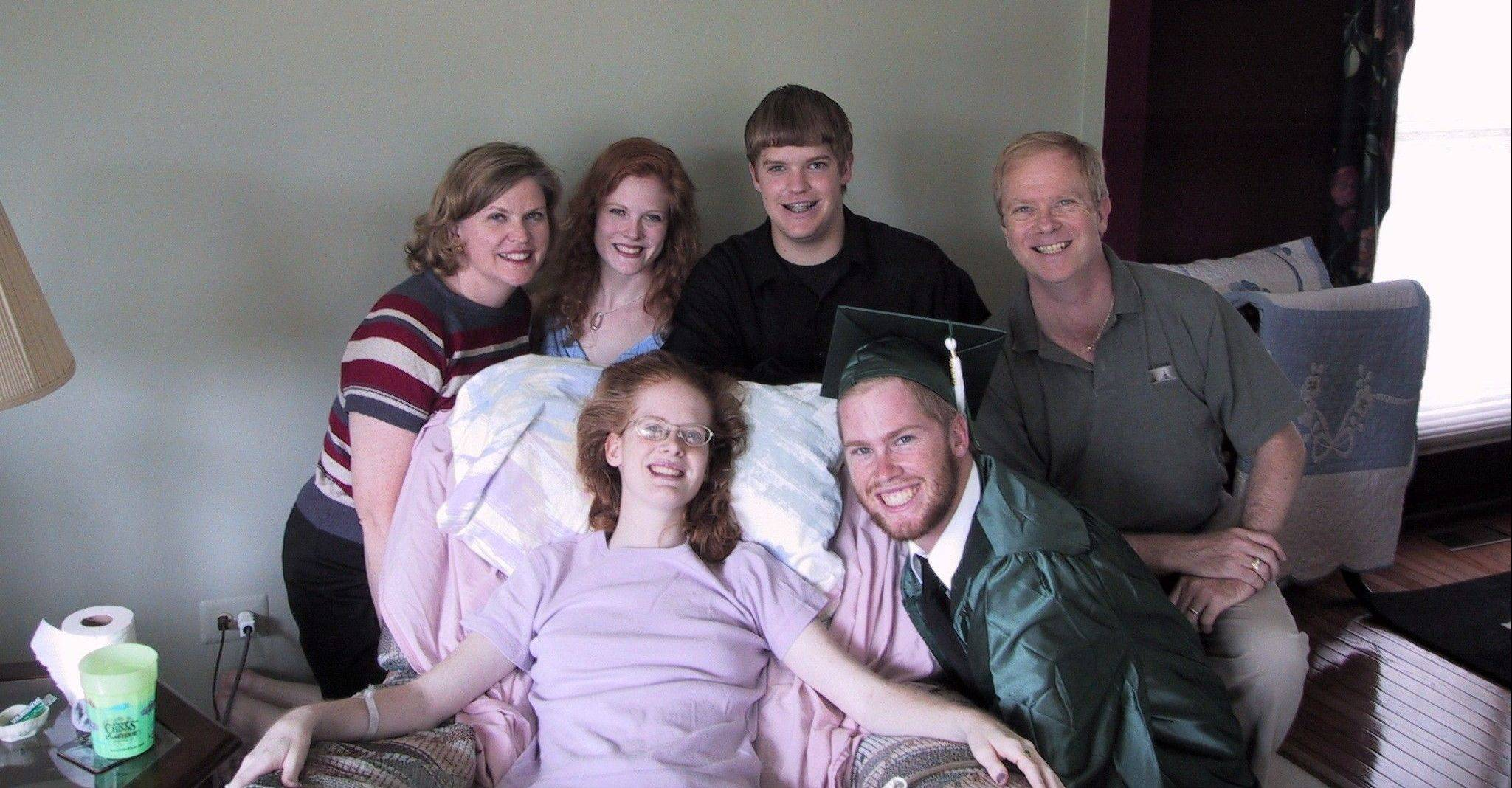 Courtesy of Amanda RichterThis 2002 photograph of college student Amanda Ball of Grayslake recovering from meningitis shows her biggest supporters: parents, Earl and Mary; sister, Jenni; and brothers, Chris and James.