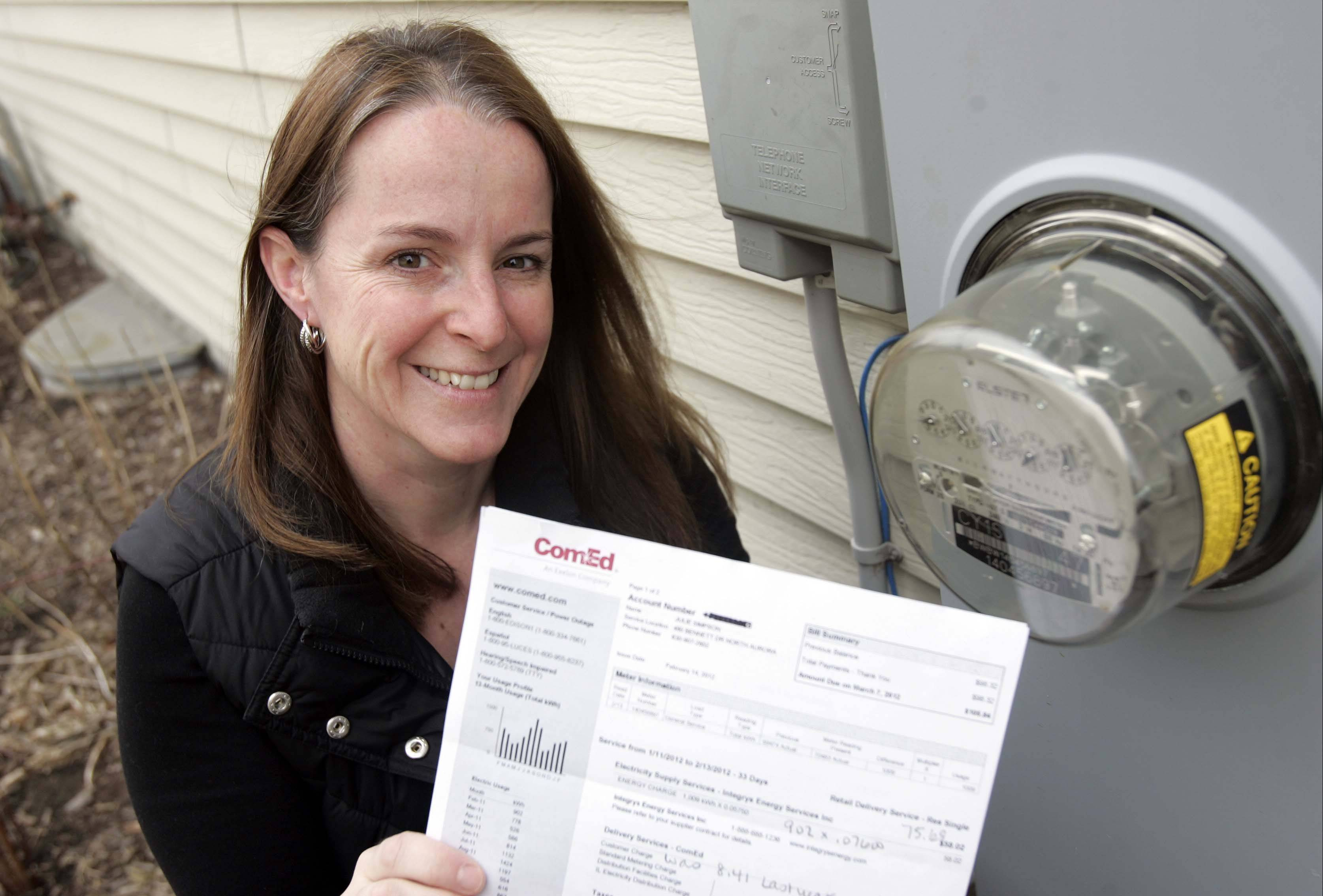 Brian Hill/bhill@dailyherald.com Julie Simpson of North Aurora says she is glad her town went for municipal aggregation of electricity because now she is saving almost 30 percent on the supply portion of her electric bill.