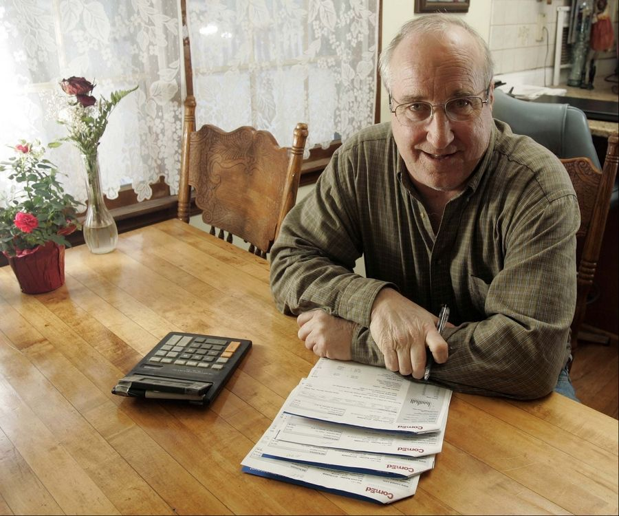 Brian Hill/bhill@dailyherald.comDavid Witchie of Fox River Grove is happy with his new electric bill since Fox River Grove switched to a new electricity supplier last September.