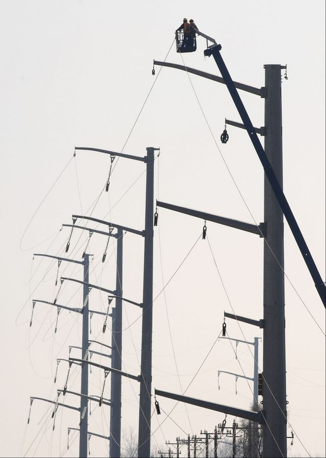 CHRISTOPHER HANKINS/chankins@dailyherald.com, 2009ComEd doesn't lose any money from municipal aggregation of electricity because it only makes a profit from delivery services. These are ComEd's power line towers along the Jane Addams Tollway in Huntley.