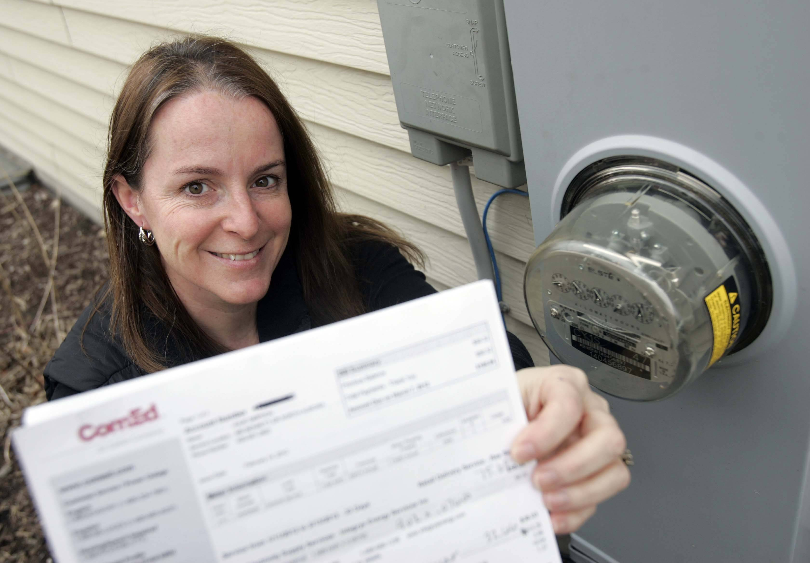 Brian Hill/bhill@dailyherald.comJulie Simpson of North Aurora says she is glad her town took the initiative to go for municipal aggregation of electricity because now she is saving almost 30 percent on the supply portion of her electric bill.