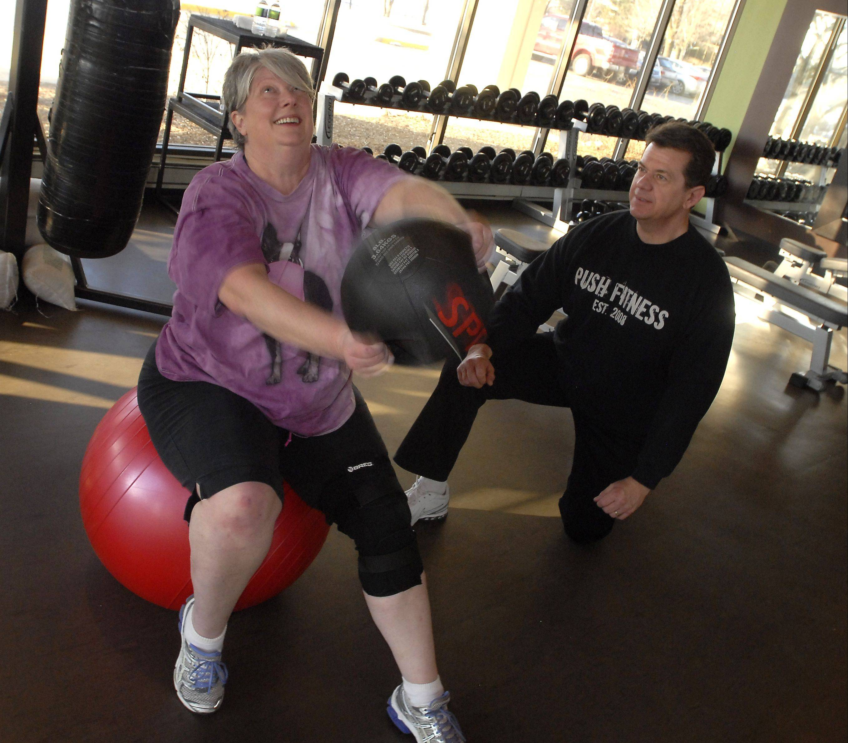 While her knee heals, Catherine Edman's trainer, George Gersch, is concentrating on upper-body exercises.