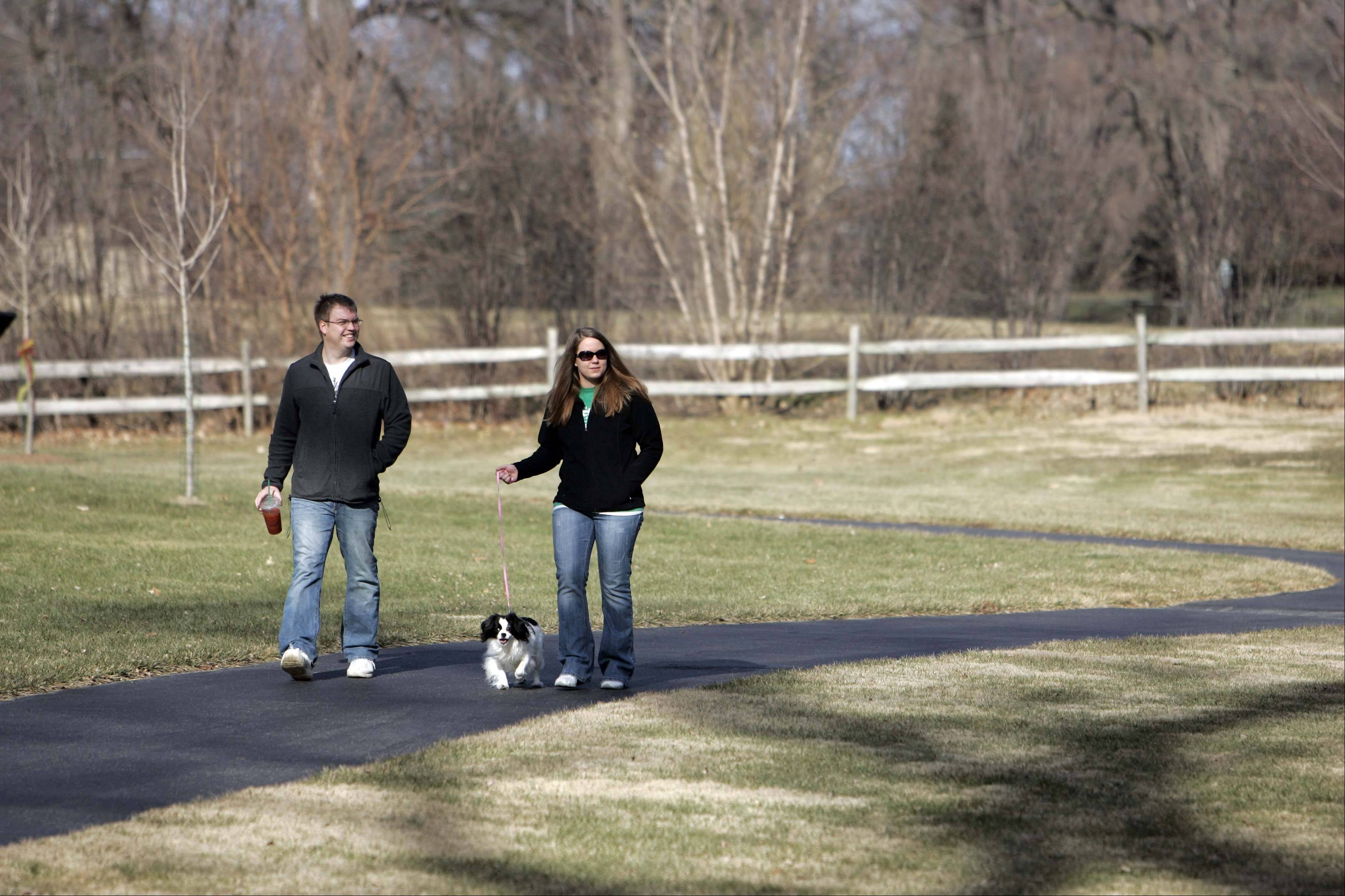 John and C.J. Stahl of Elgin enjoy a walk through Delnor Woods Park with their dog Q-Tipp during a warm spell in January. An additional 19.1 acres of land, previously owned by the Dellora A. Norris Trust, will bring Delnor Woods' footprint to 42 acres.