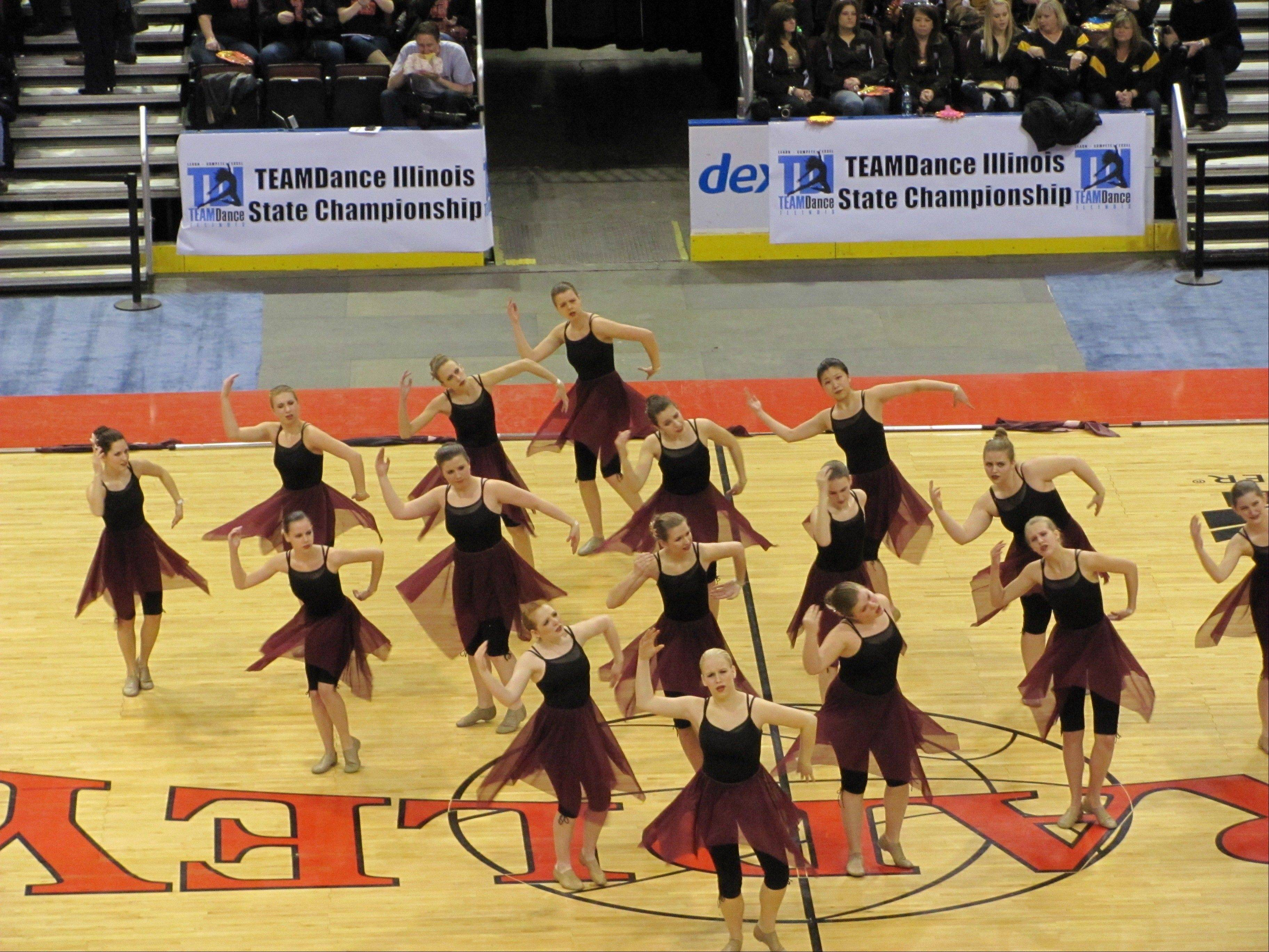 PHOTO COURTESY OF District 211The Fremd Vikette Flag Team performs at the Team Dance Illinois competition in Peoria on Sunday. The team was named the traditional flag grand champion after placing first out of five teams.