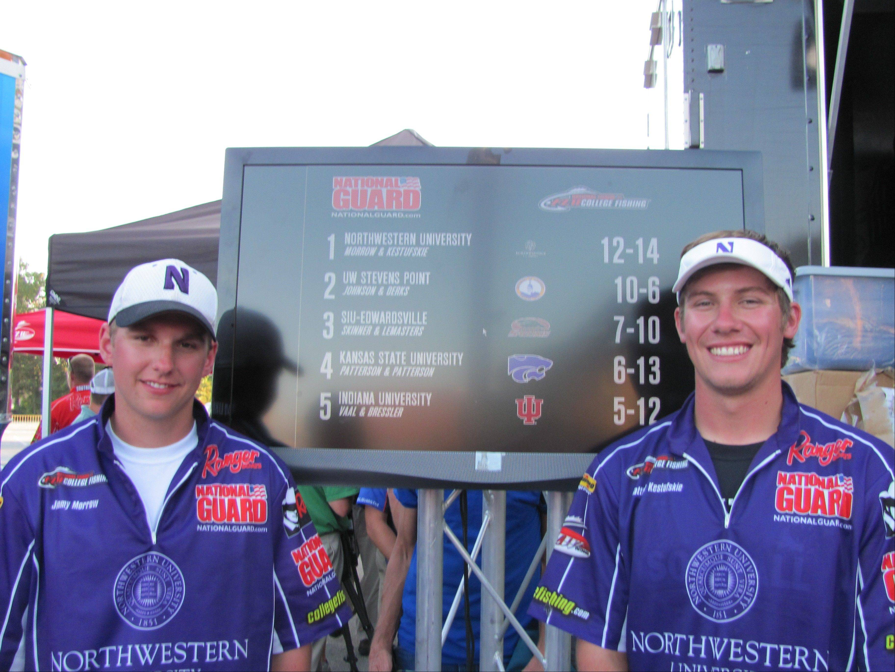 Jimmy Morrow of Arlington Heights and his Northwestern University teammate, Matthew Kestufskie, celebrate their regional win. The pair next month will compete in the National Guard FLW College Fishing National Championships.
