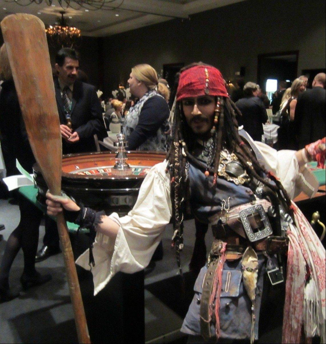Captain Jack Sparrow impersonator Rick Aspen greets guests of the 11th annual Mardi Gras and Casino Gala hosted by the Schaumburg Township Elementary School Foundation.