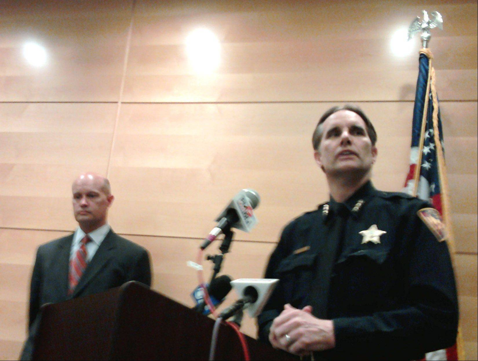 Kane County State's Attorney Joe McMahon, left, and Aurora Police Chief Greg Thomas explain the decision to vacate the murder conviction of Jonathan Moore Thursday. Moore was convicted and sentenced to 75 years for the 2000 killing of Shawn Miller, 20, of Montgomery. Moore is now a free man.