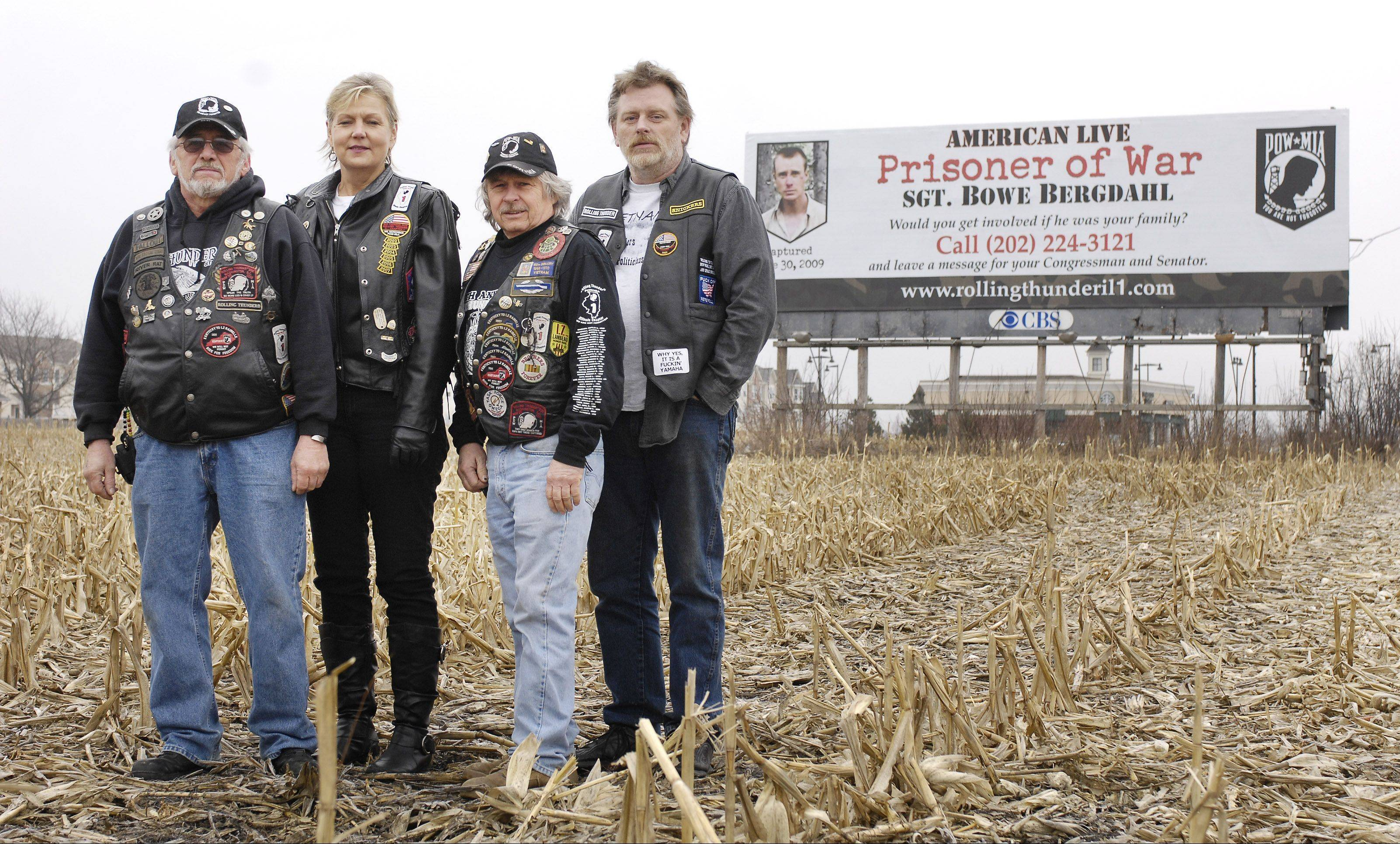 Bill Atkinson of Carol Stream, Ronda Mahar of Wheaton, Bill Sharpness of Kingston and Jim Slenk of Batavia are members of Rolling Thunder Chapter 1, a veterans group that rented three billboards, including one in Hanover Park, to call attention to the plight of American POW Sgt. Bowe Bergdahl.