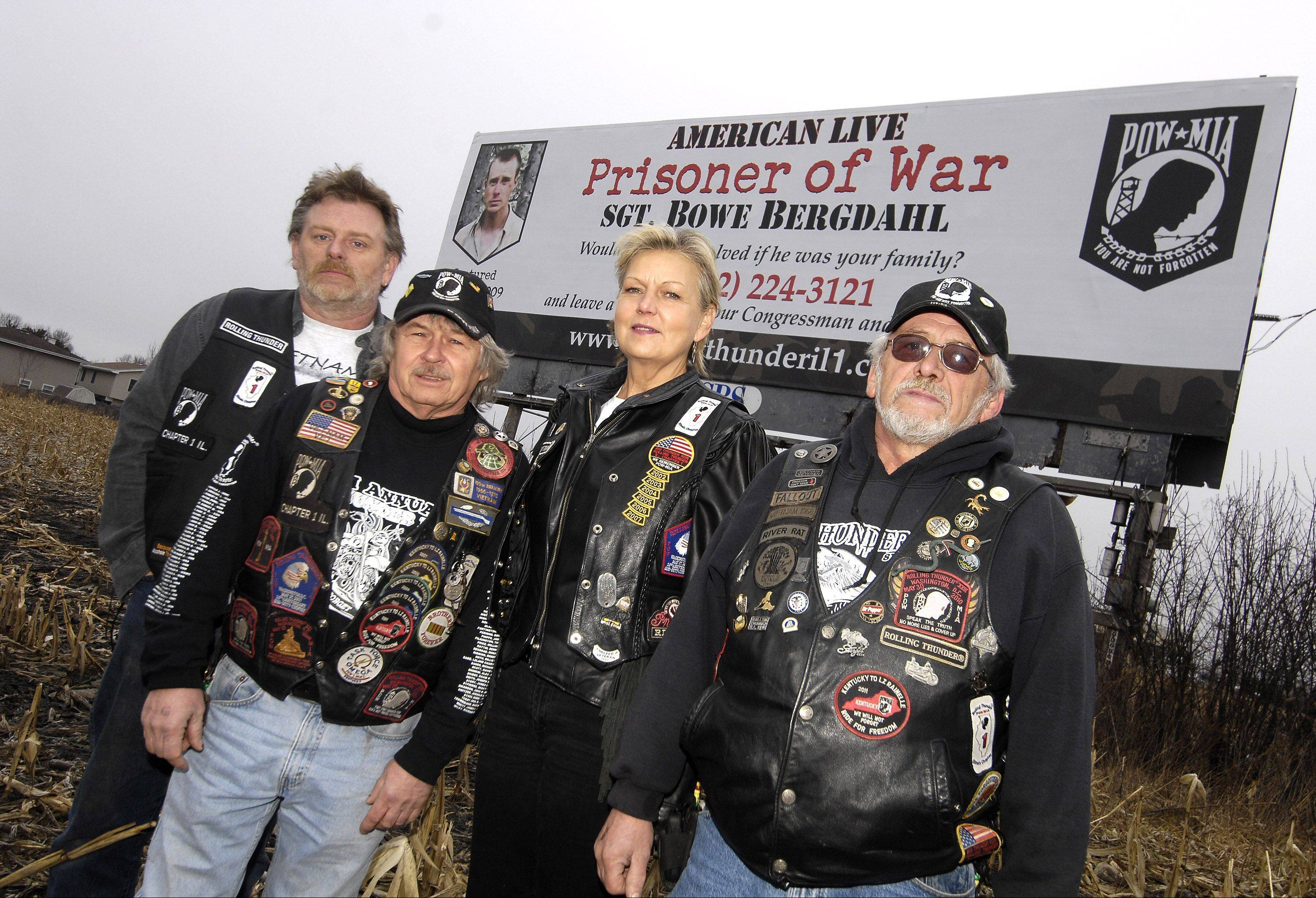 Members of Rolling Thunder Chapter 1 veterans group -- including, from left, Jim Slenk of Batavia, Bill Sharpness of Kingston, Ronda Mahar of Wheaton and Bill Atkinson of Carol Stream -- rented billboards, including one in Hanover Park, to call attention to the plight of the lone American POW, Sgt. Bowe Bergdahl of Idaho.