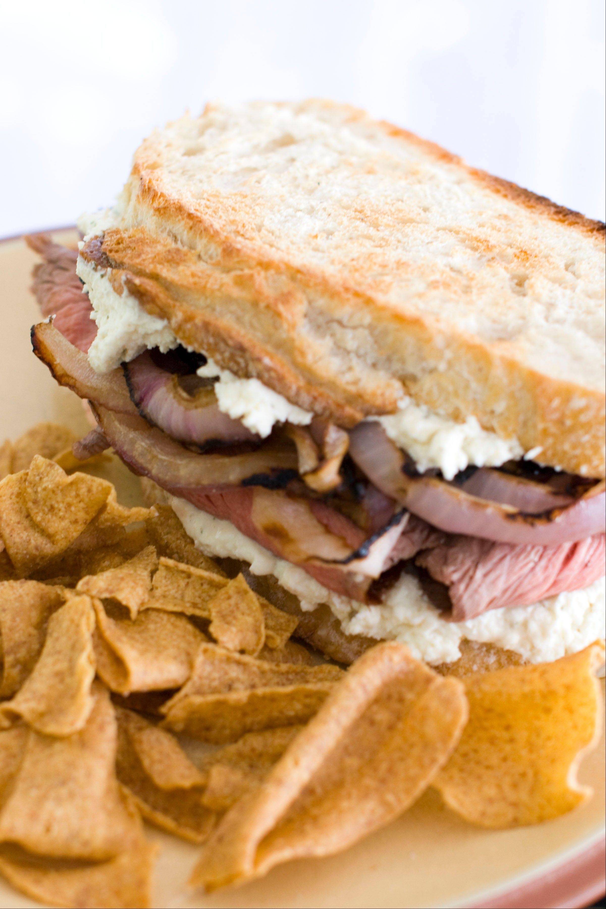 Guinness Marinated Flank Steak Sandwiches with Grilled Onions and Boursin Cheese