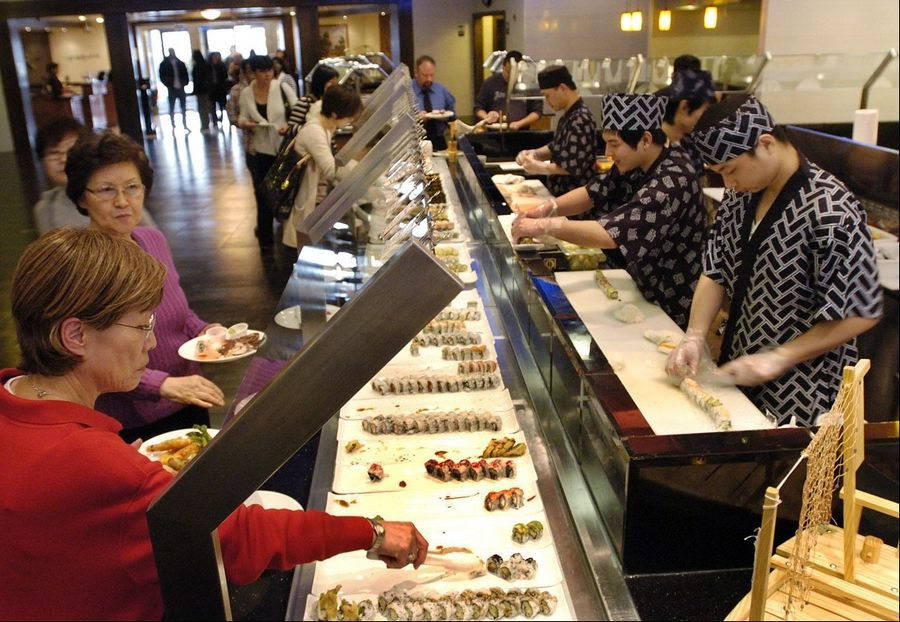 Sushi chefs continually replenish the stations at Royal Japanese Seafood Buffet in Hoffman Estates.