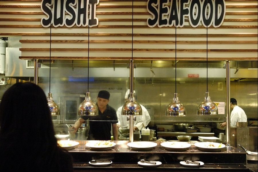 The open layout of Royal Japanese Seafood Buffet allows diners to watch sushi and more being crafted in front of them.