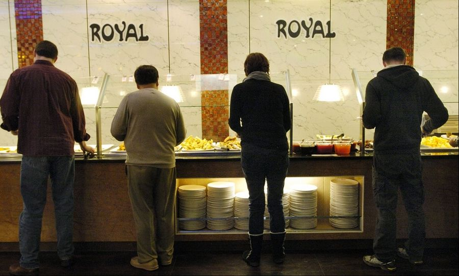 Lunchtime diners help themselves from the cold food stations at Royal Japanese Seafood Buffet in Hoffman Estates.