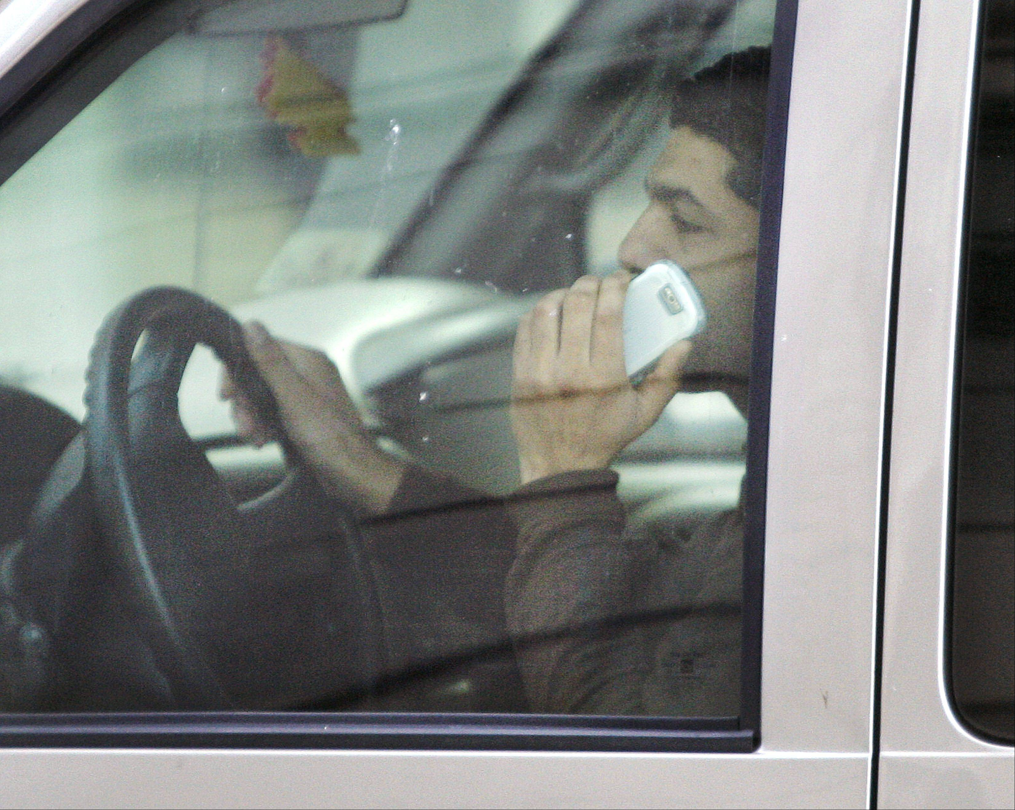 Illinois lawmakers voted Thursday to ban talking on the phone while driving.