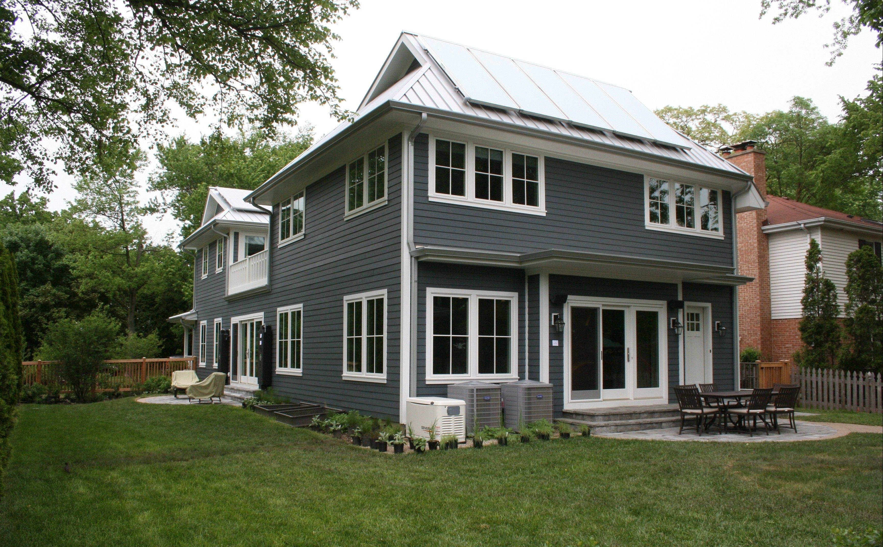 Scott Simpson Builders earned Platinum LEED certification for this energy-efficient farmhouse in Glencoe. Solar energy use is incorporated into it's traditional architectural design.