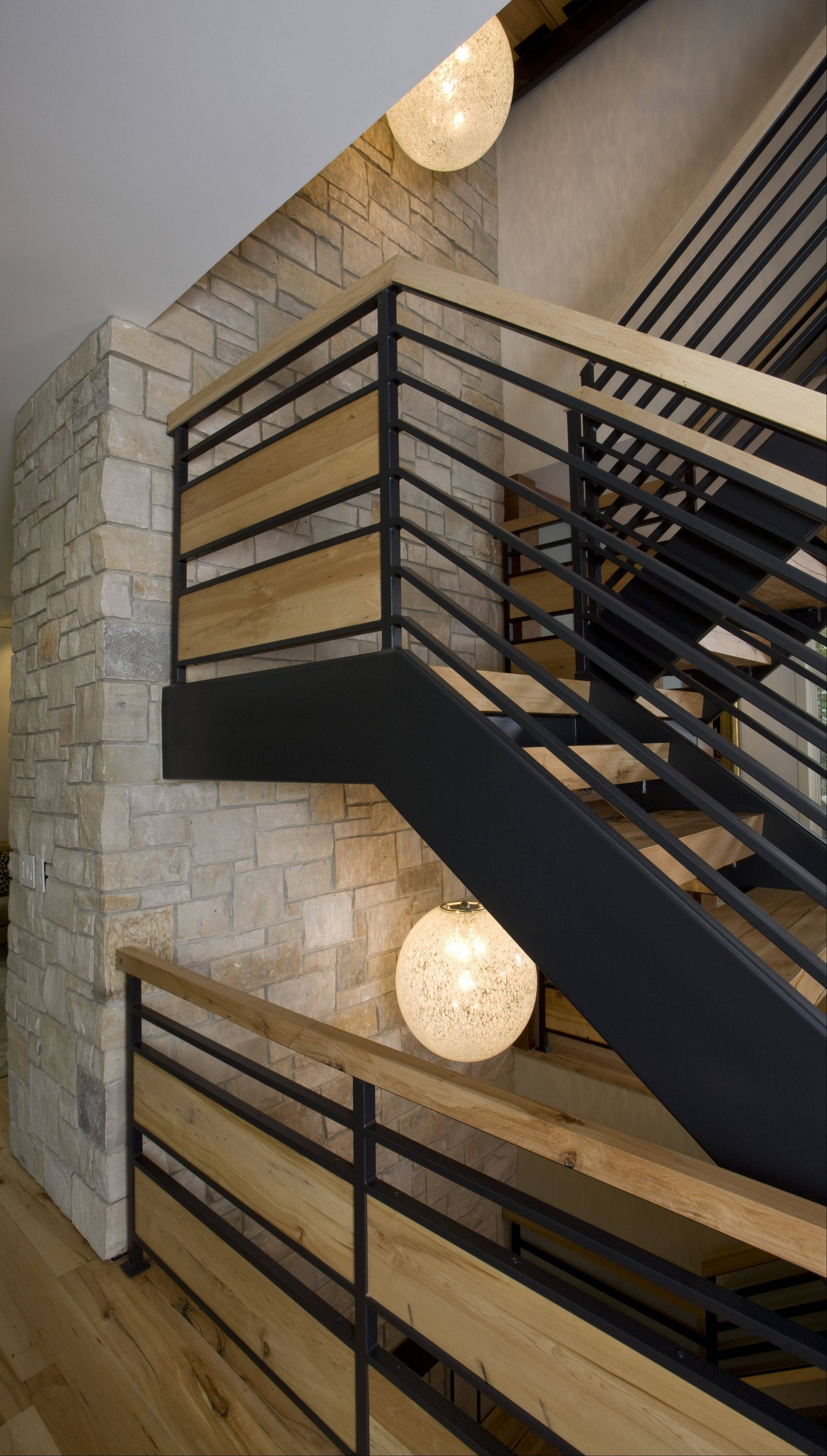 Reclaimed maple stair risers in this Wilmette home were made with factory timbers salvaged from a historic Simmons Furniture Factory in New London, Wis.