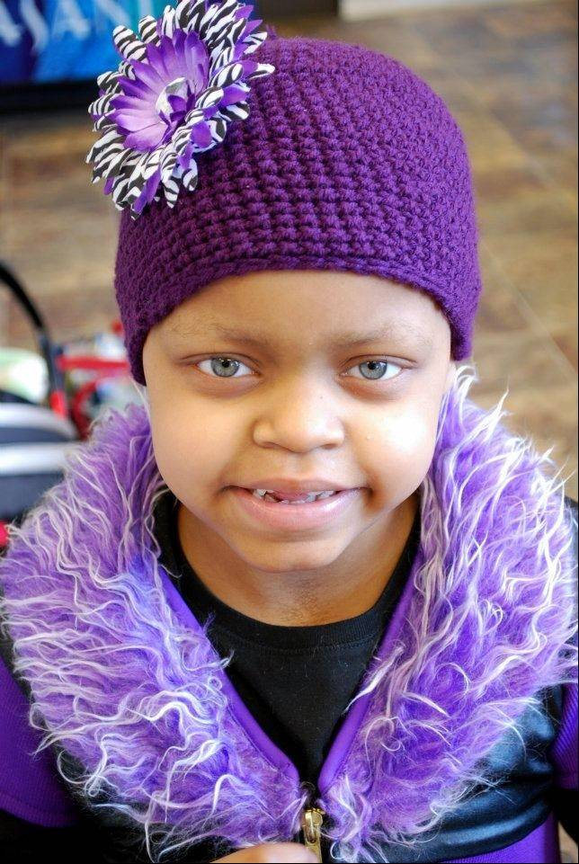 Lily Smith, a second grader at Cotton Creek School in Island Lake, is battling angiosarcoma, an aggressive, rare cancer not often found in children.