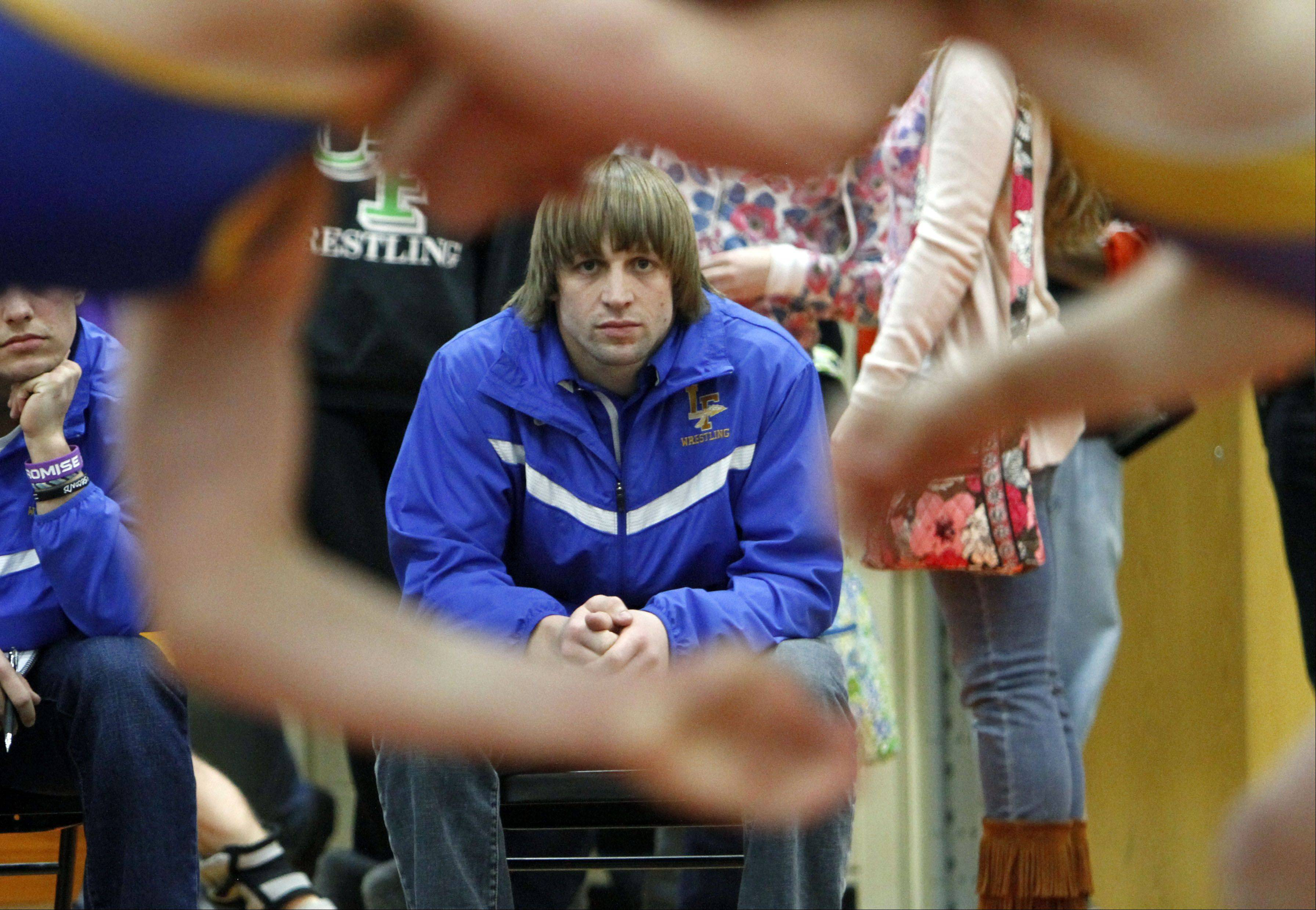 Matt Fiordirosa watches his wrestler Regis Durbin during the North Suburban Conference wrestling championships in Libertyville.