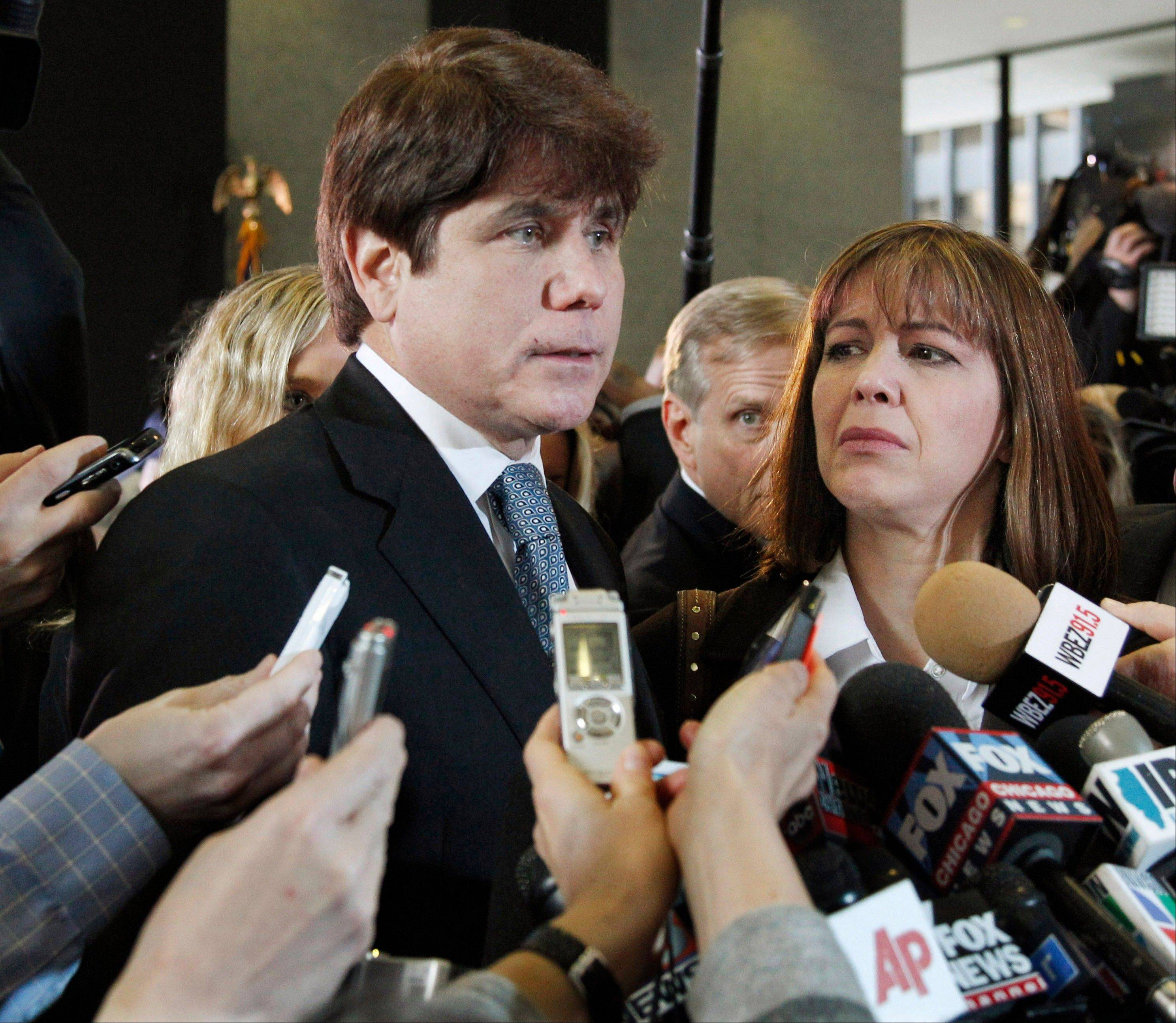 In this Dec. 7, 2011 file photo, former Illinois Gov. Rod Blagojevich, left, speaks to reporters as his wife, Patti, listens at the federal building in Chicago after being sentenced to 14 years on 18 corruption counts, including trying to auction off President Barack Obama's old Senate seat. Blagojevich says he would like to maintain his dignity through the difficult process of leaving his family to report to prison. But as with every other step in the long saga of his corruption scandal, there will be much interest in his final journey from his Chicago home to his expected prison in Colorado. He is scheduled to report on March 15.