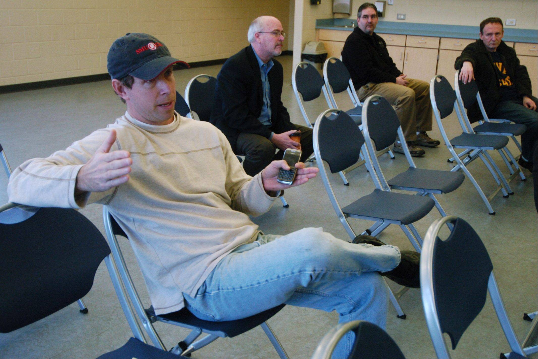 Craig Niemiec of Arlington Heights asks a question during an Arlington Heights Park District forum held at Pioneer Park Saturday to discuss a $48 million ballot referendum.