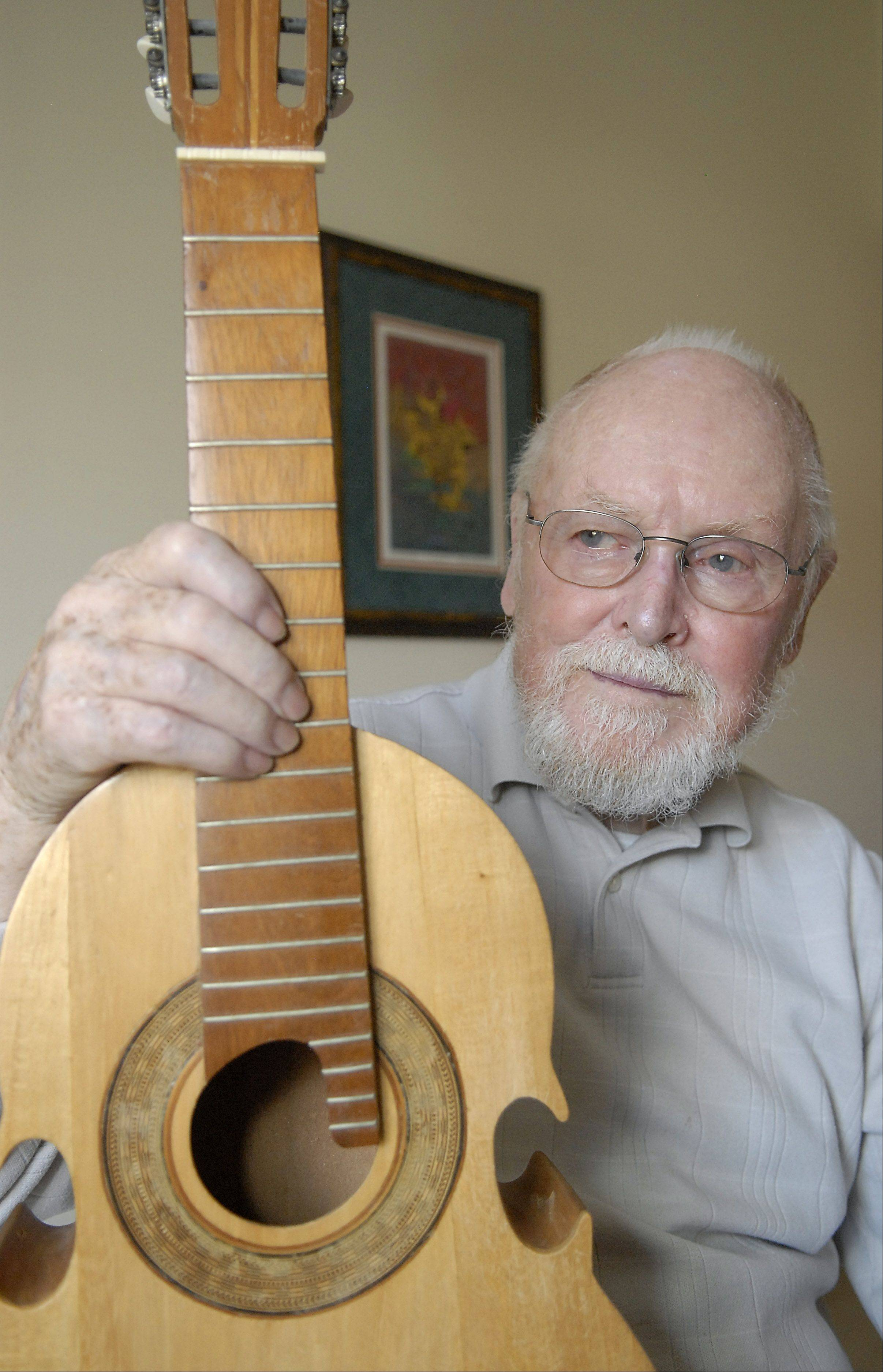 Ken Page and his cuatro, which he bought in the late 60s. The Puerto Rican guitar is made from a single piece of wood. Page, 85, worked for Sears throughout Latin America. He also used to play the guitar and dulcimer.
