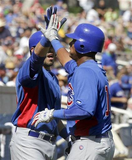 Chicago Cubs' Starlin Castro, right, celebrates his home run with Geovany Soto during the fourth inning of a spring training baseball game against the Milwaukee Brewers in Phoenix on Saturday.