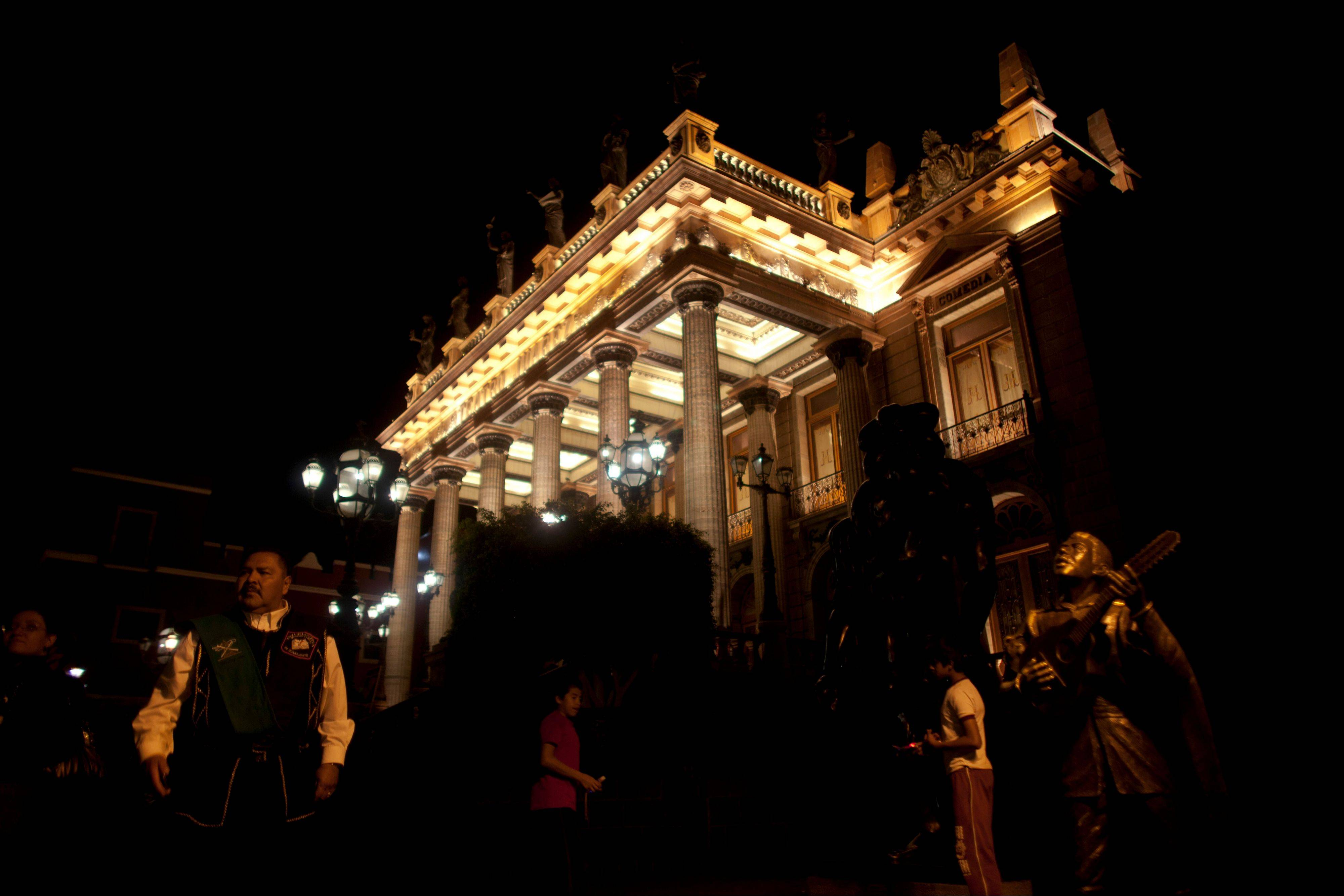The Juarez theater is lit at night in the colonial city of Guanajuato, Mexico.