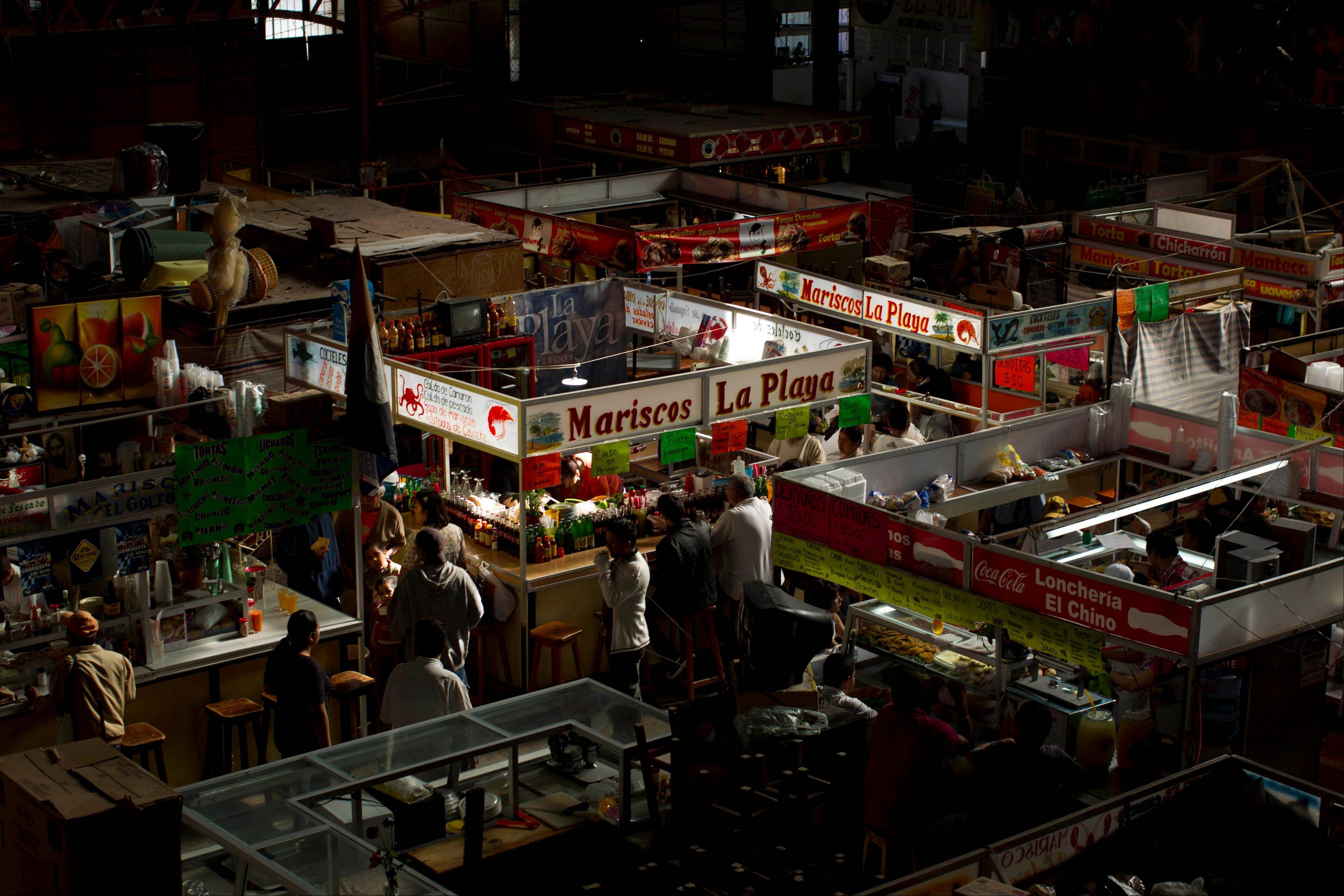 People eat at the traditional food stands inside Guanajuato's central market.