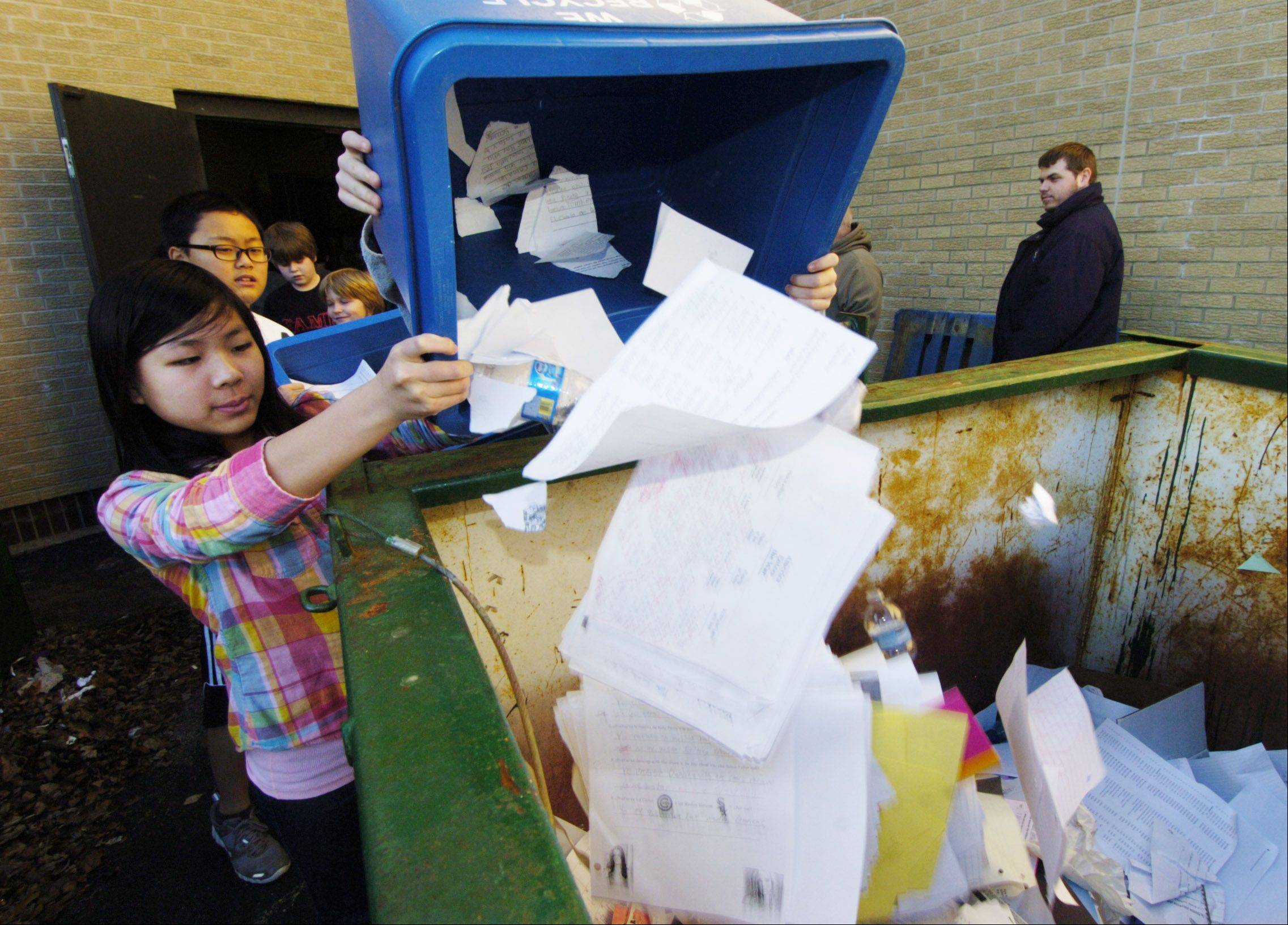 JOE LEWNARD/jlewnard@dailyherald.comJasmine Mui is among a group of sixth-graders depositing material for recycling, which is part of a yearlong service learning project at Field Middle School in Northbrook.