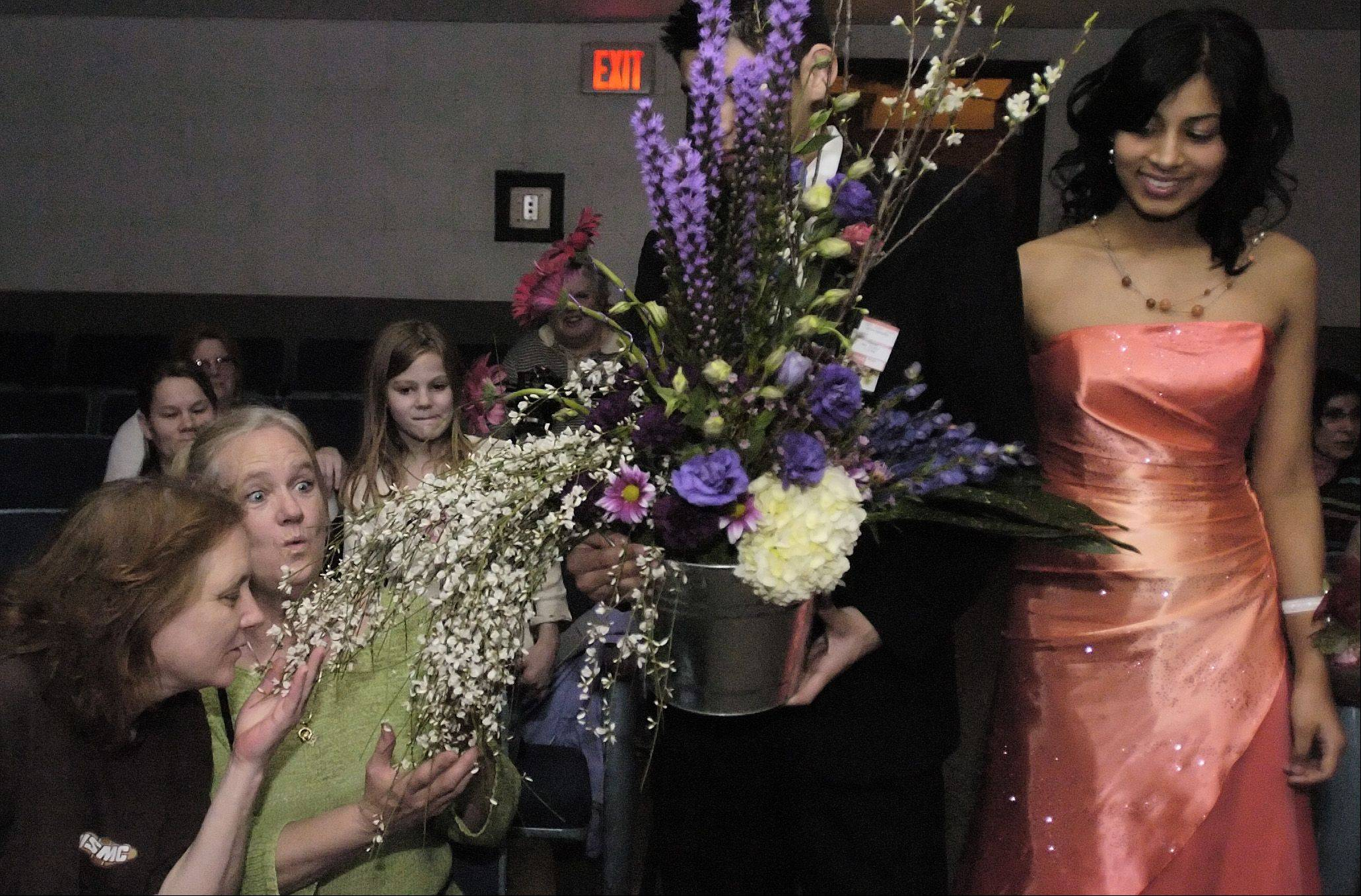 Students dressed in formalwear will parade floral creations around the audience at Addison Trail High School's 40th annual flower show Tuesday, March 13.