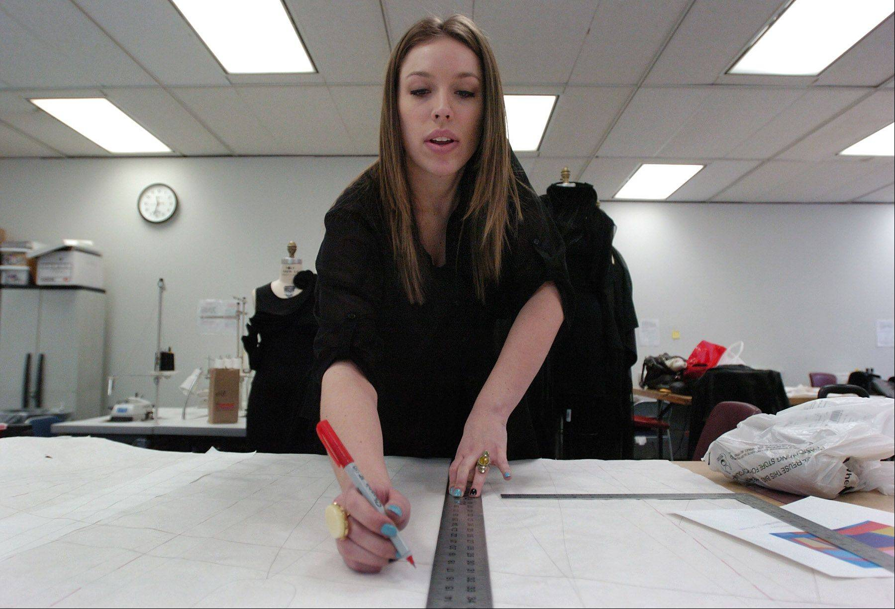 Fashion design student Ali Forsythe, working on a project in her class at Harper College, recently placed second in a national contest with her design of a cardigan made of alpaca fur. The 20-year-old from Mount Prospect hopes to open her own boutique after earning a fashion degree.