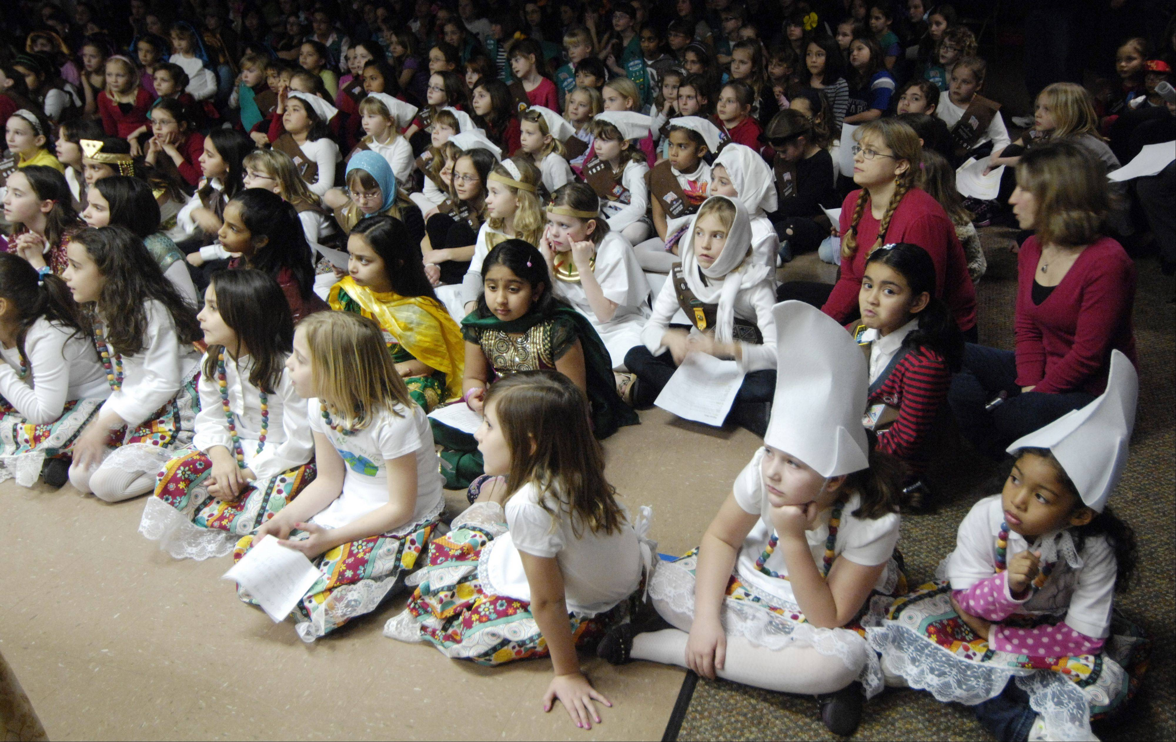 Scouts watch skits during Girl Scouts World Thinking Day held earlier this month at the Society of the Danube Swabians in Des Plaines. The Girl Scouts mark their 100th anniversary today.