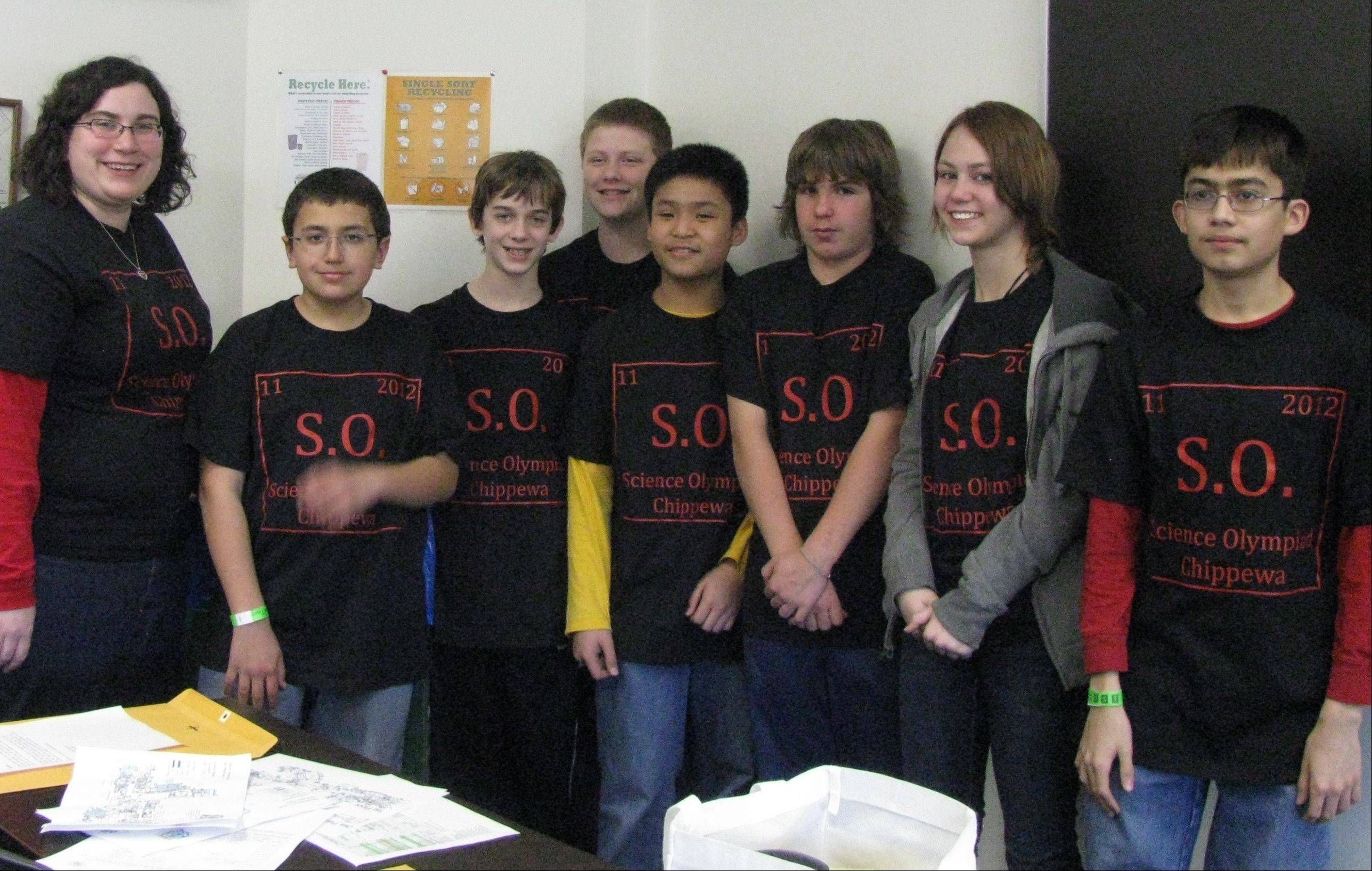 Chippewa Middle School teacher Elizabeth Donoghue with Science Olympiad participants Leo Rodriguez, left, Erik Klingenberg, Brian Bojarski, Chris Jew, Nick Stone, Hannah Taylor and Xavier Cardenas.