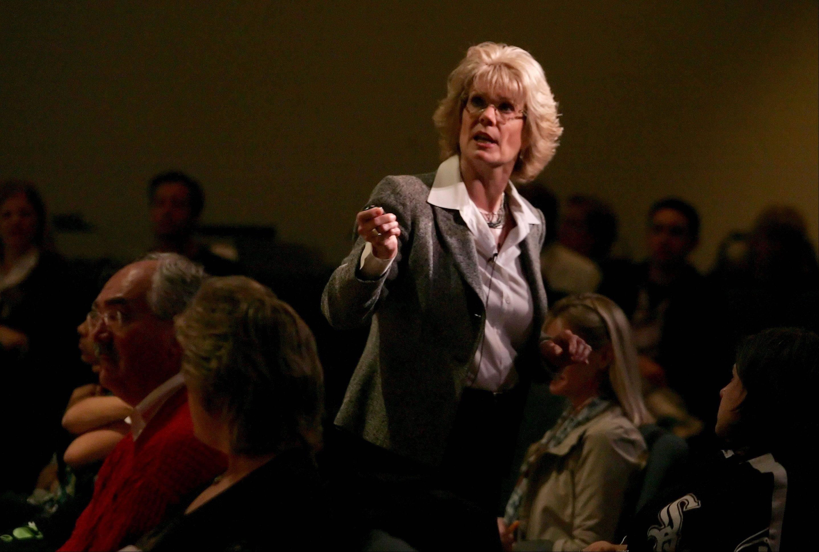 "Kimberly Groll, addiction health therapist, gives a presentation during ""Heroin: Stemming the Tide"" at Wheatland Salem Church in Naperville on Monday."