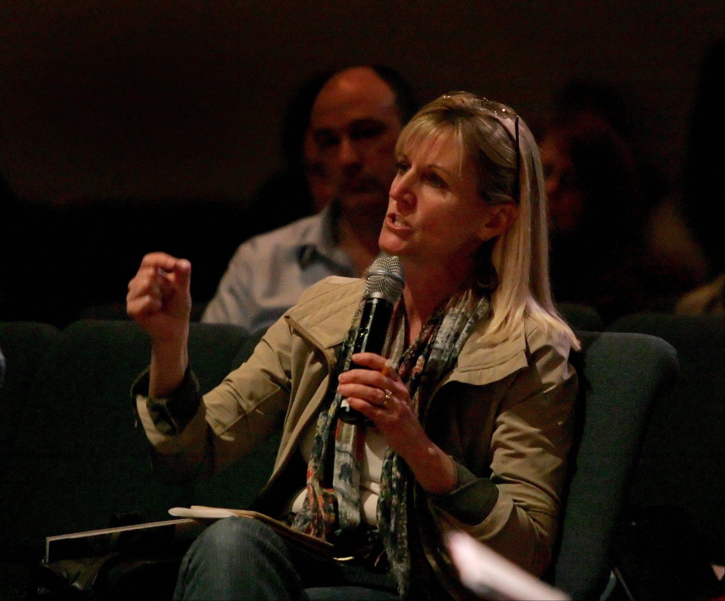 "Concerned parent Laura Thomas of Naperville asks a question during the program ""Heroin: Stemming the Tide"" at Wheatland Salem Church in Naperville on Monday. She feels money could be used through the Department of Human Services to put counselors into schools."