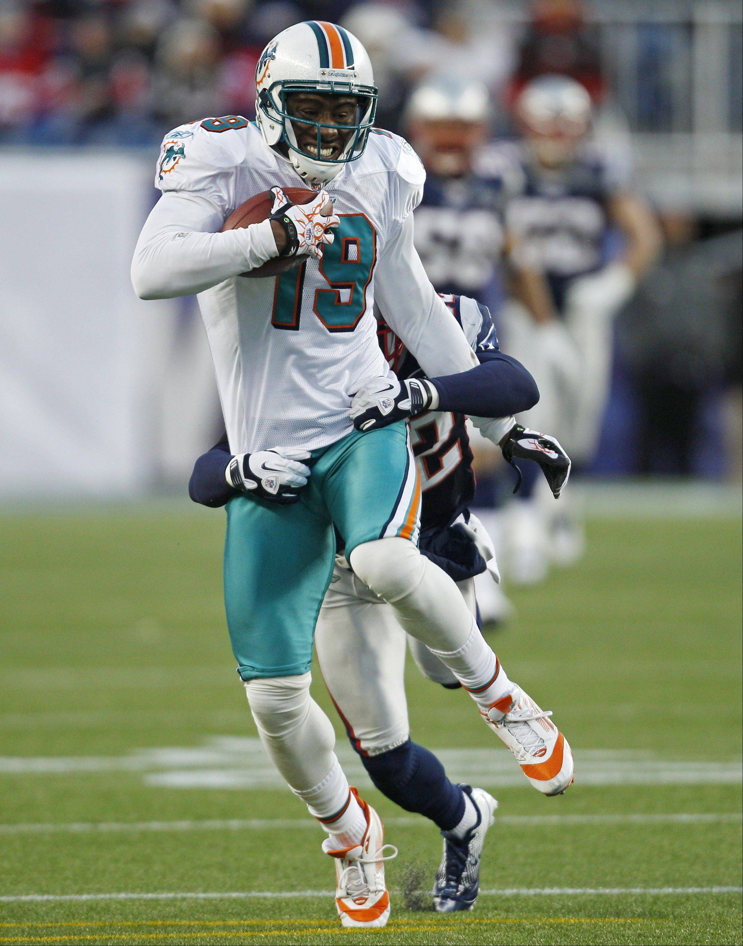 Miami Dolphins wide receiver Brandon Marshall (19) against the New England Patriots in the second half of an NFL football game in Foxborough, Mass., Saturday Dec. 24, 2011.