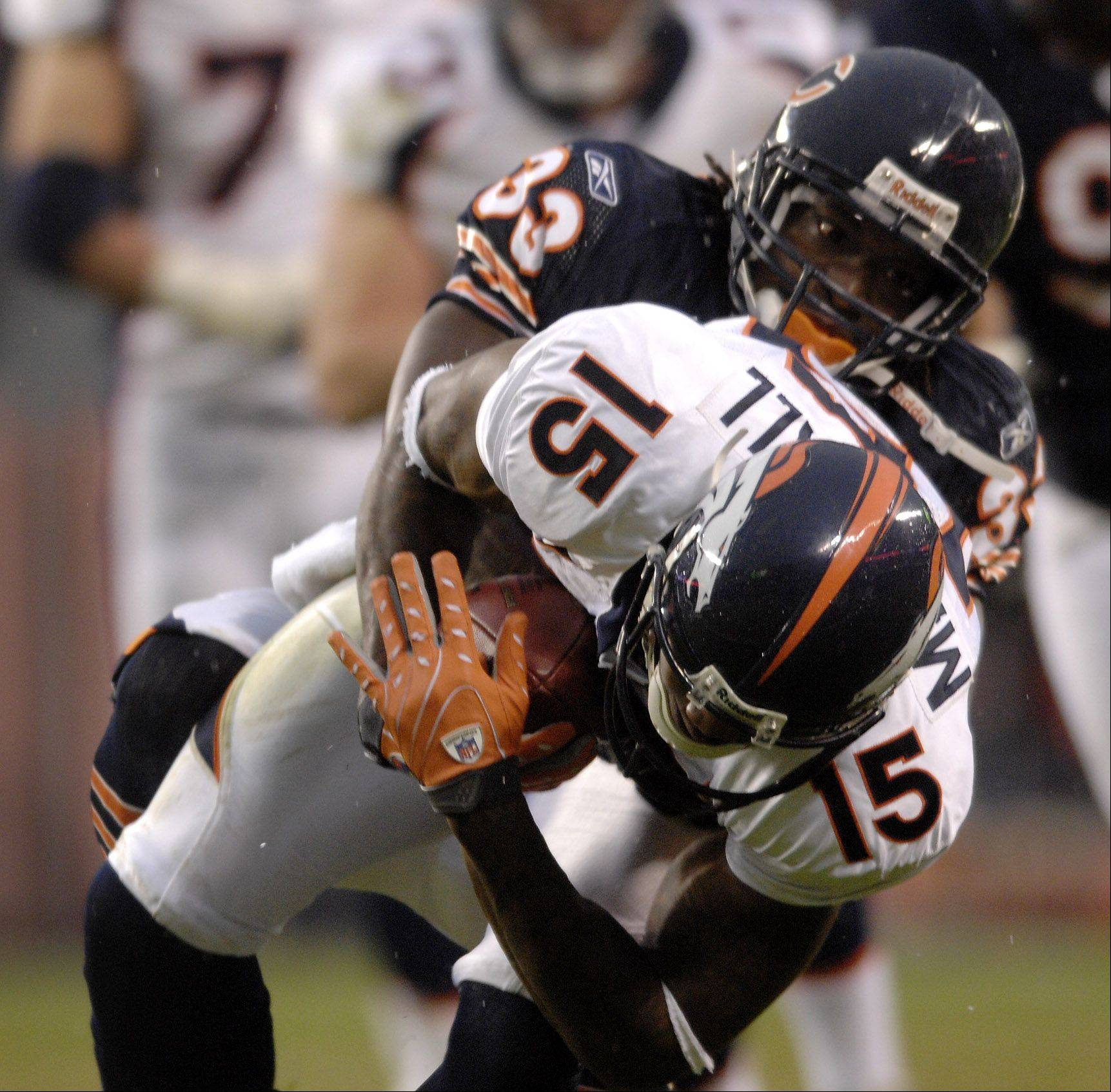 Charles Tillman of Chicago Bears takes down Brandon Marshall of the Denver Broncos at Soldier Field in Chicago.