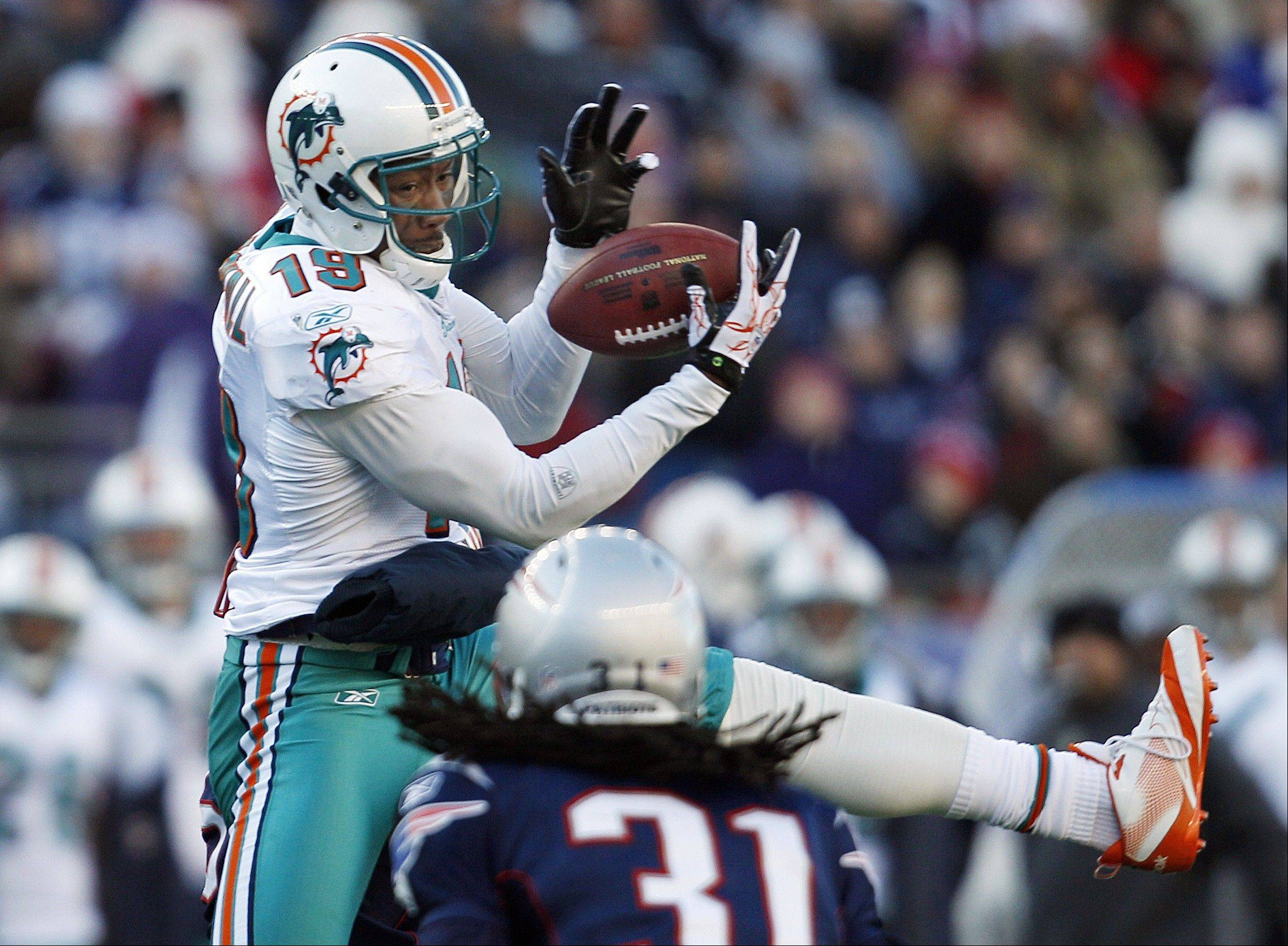 Miami Dolphins wide receiver Brandon Marshall (19) is headed to the Chicago Bears, who traded two third-round draft picks for the star receiver.