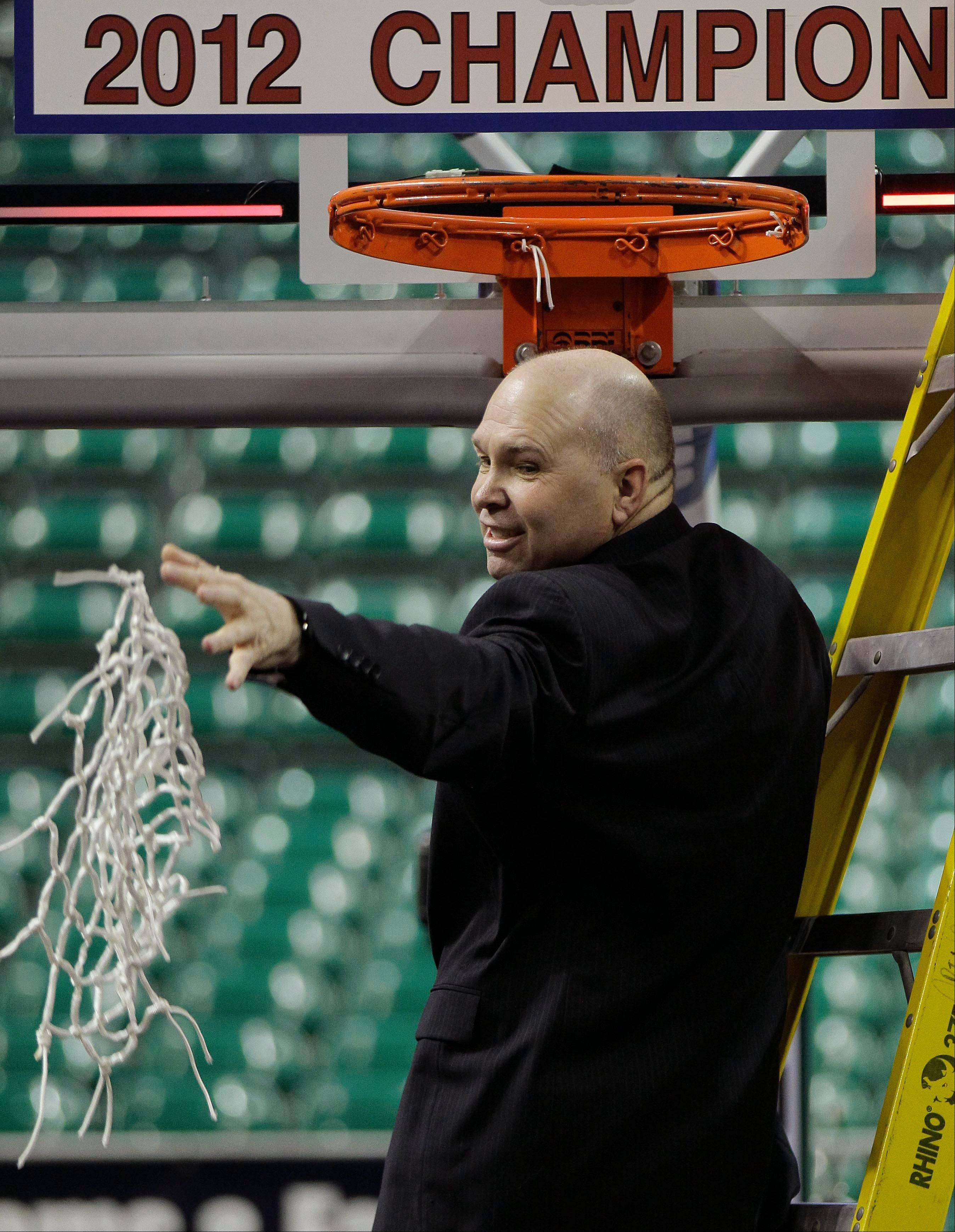 Saint Mary's coach Randy Bennett throws the net to his players after cutting it down after beating Gonzaga 78-74 in overtime in an NCAA college basketball game in the championship of the West Coast Conference Tournament in Las Vegas.