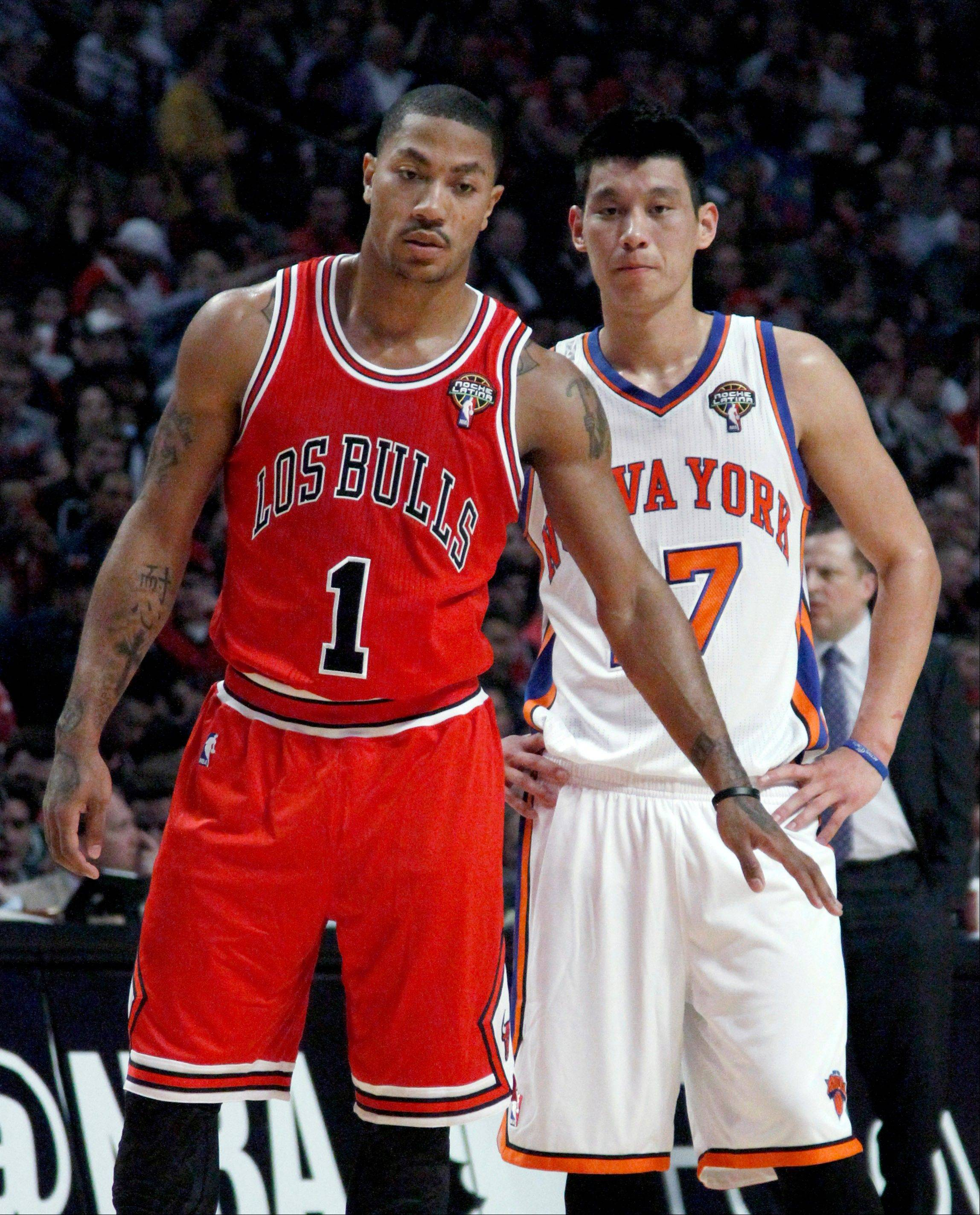 Bulls guard Derrick Rose, who finished with 32 points, stands in front of New York Knicks guard Jeremy Lin, who had 15, during a Knicks free throw Monday night at the United Center.