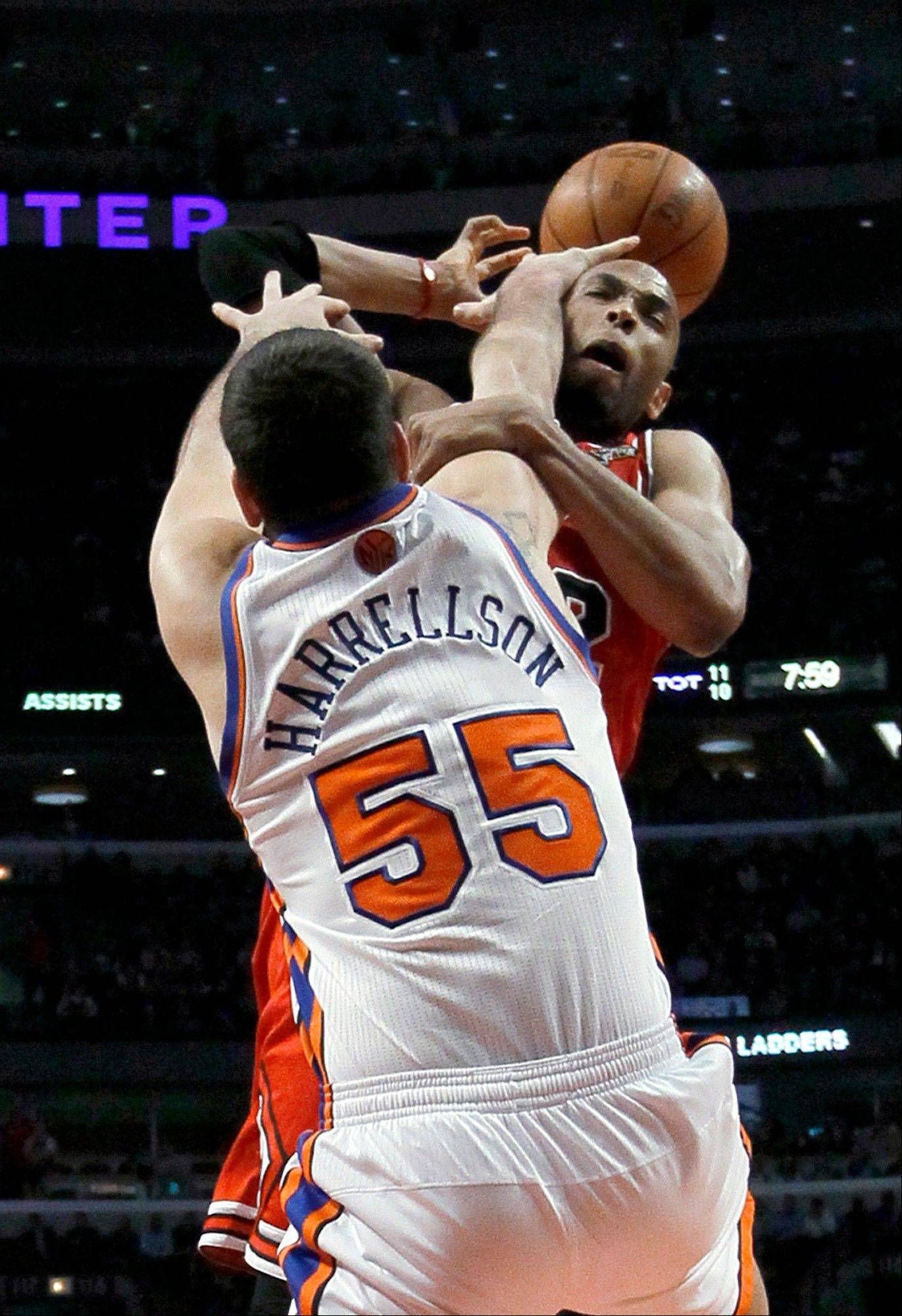 New York Knicks forward Josh Harrellson (55) fouls Chicago Bulls forward Taj Gibson during the first half of a game Monday in Chicago.