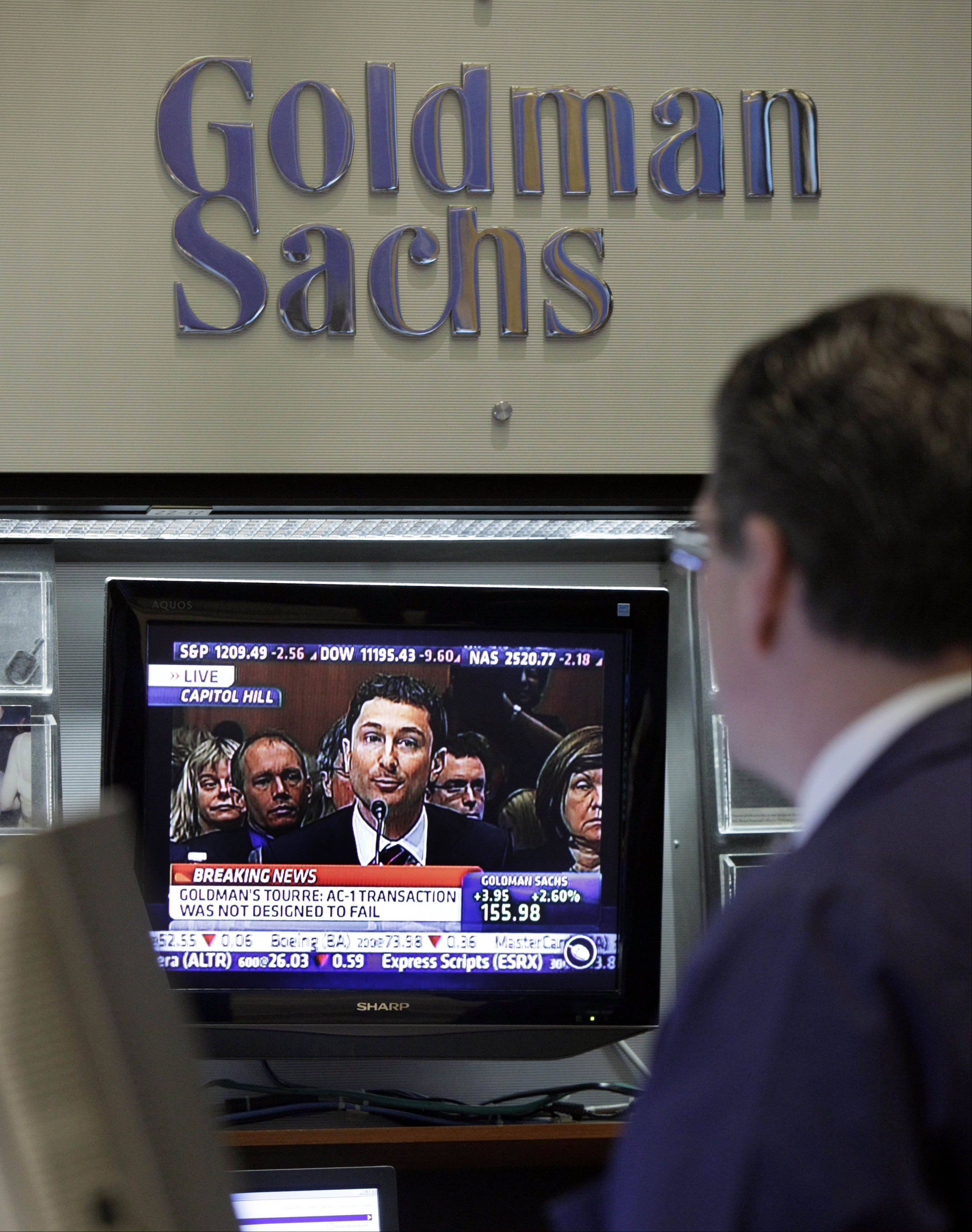 Fabrice Tourre, a 31-year-old trader at Goldman Sachs is watched on a television monitor in the Goldman Sachs booth on the floor of the New York Stock Exchange Tuesday, April 27, 2010. Tourre is testifying before a Senate panel investigating Goldman's role in the financial crisis and the Securities and Exchange Commission fraud suit against it and him.