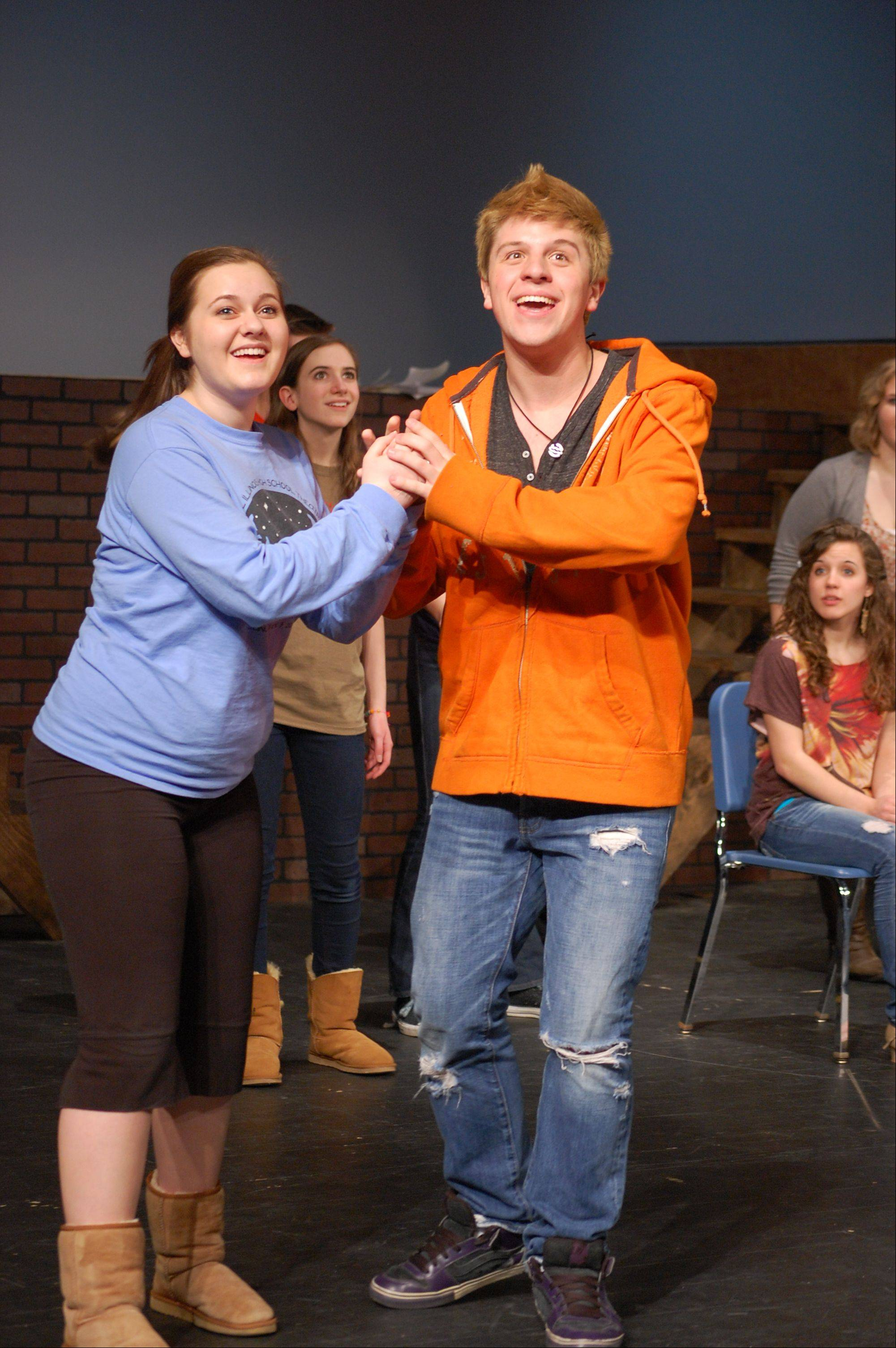 "Connor Colbert and Meredith Dillon rehearse this week for ""Urinetown -- The Musical"" at Geneva High School."