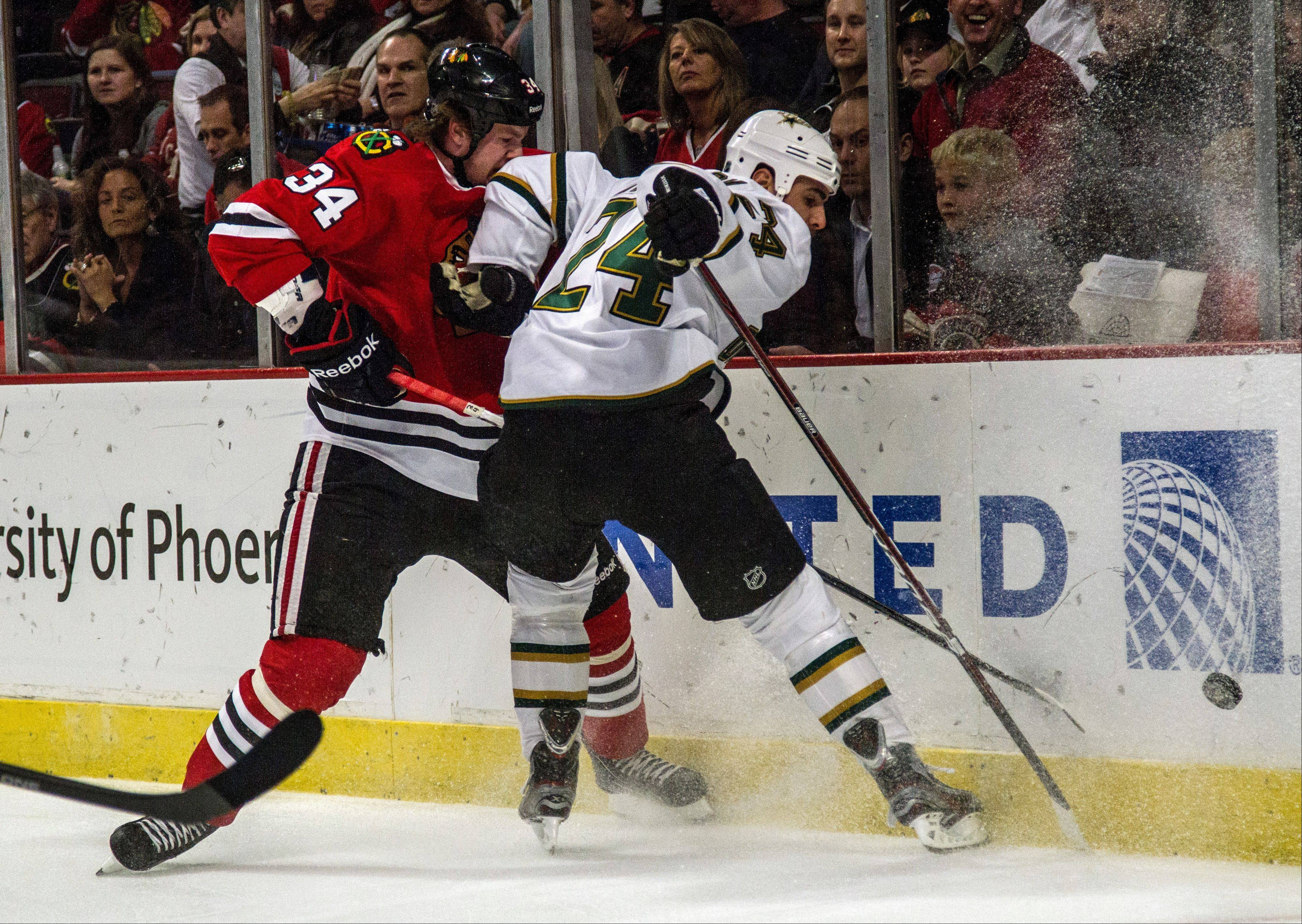 The Blackhawks' Dylan Olsen gets an elbow to the face from the Dallas Stars' Eric Nystrom while battling for the puck earlier this season.