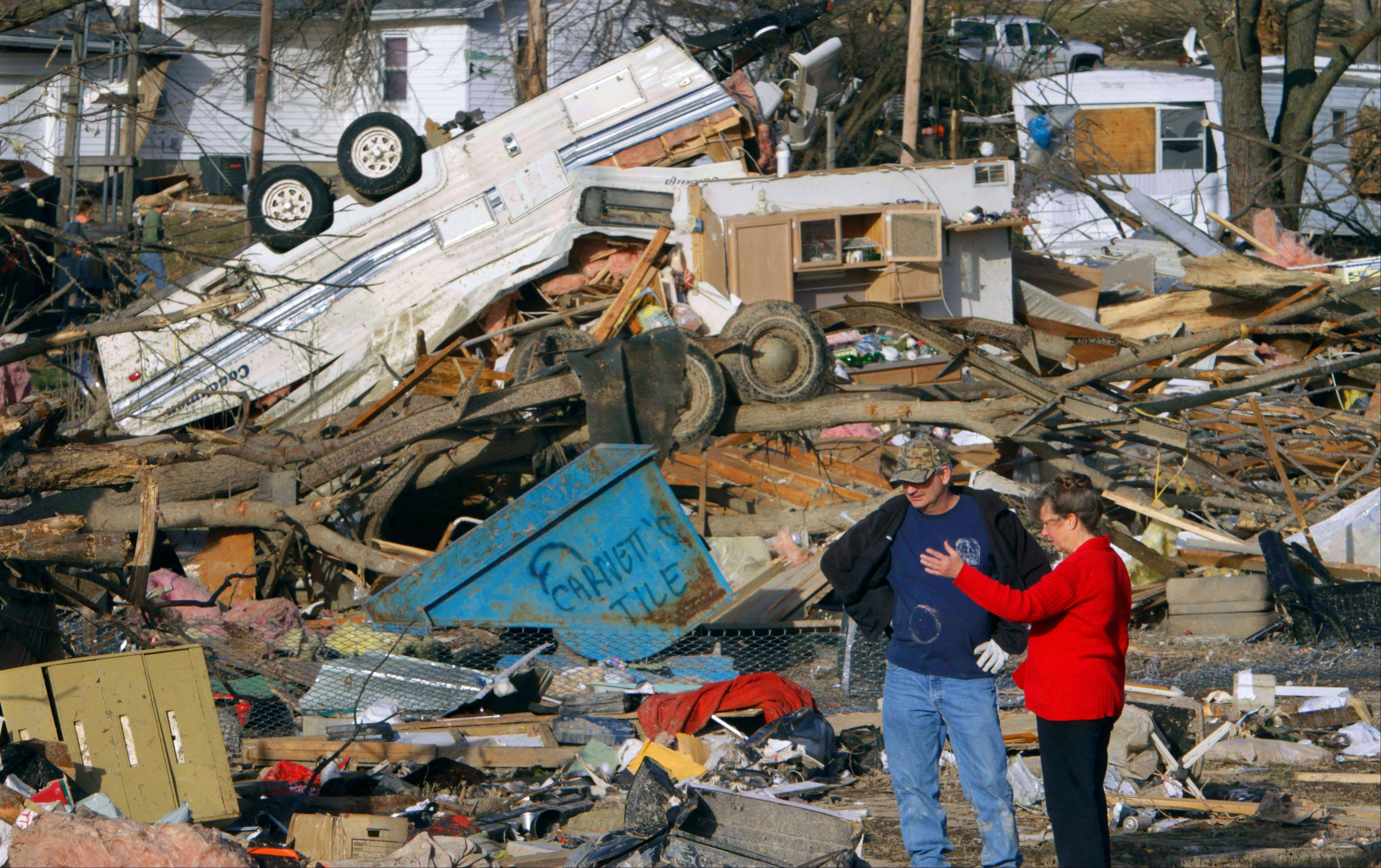People try to salvage what they can after a tornado destroyed homes in downstate Harrisburg on Feb 29.
