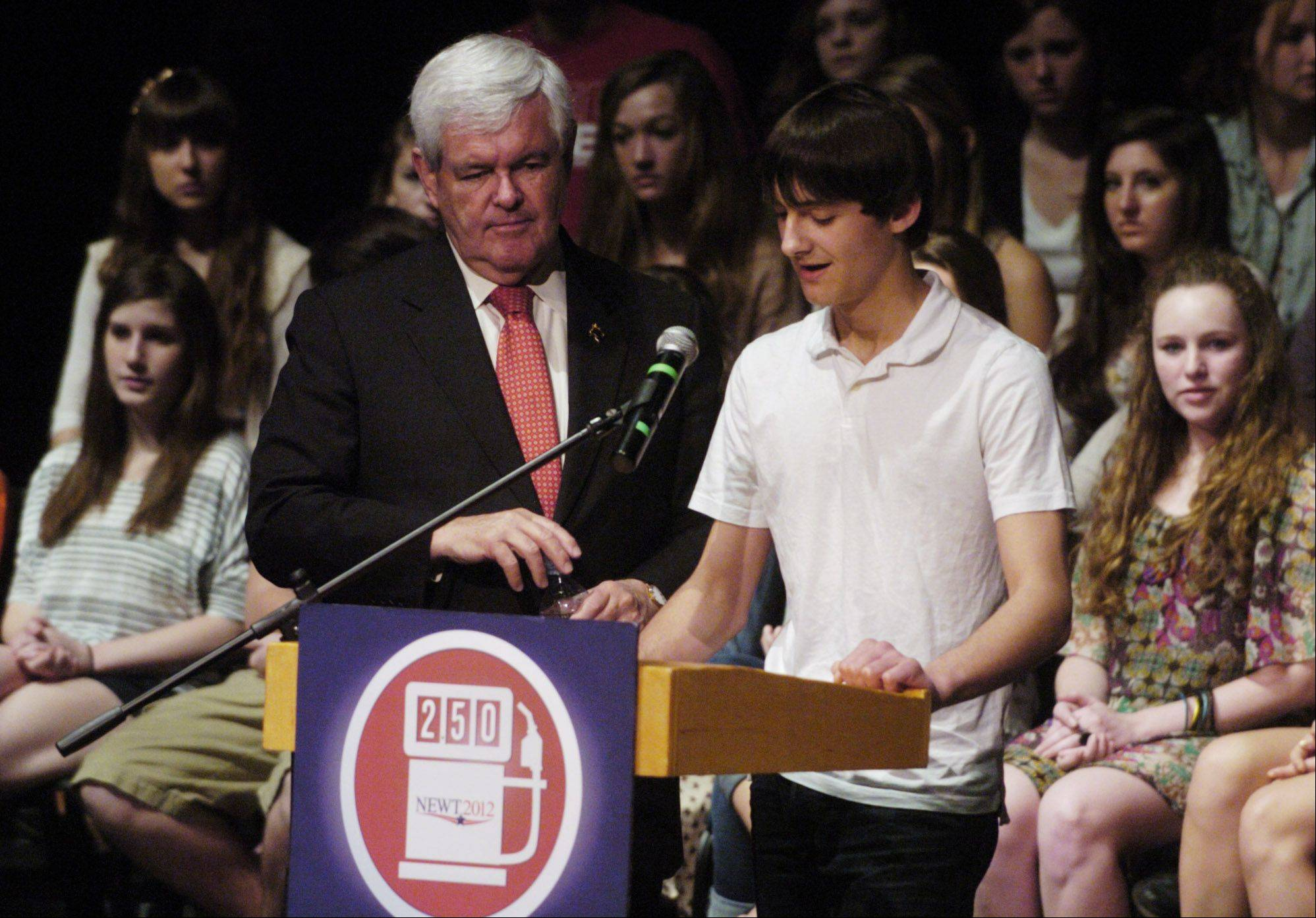 Barrington High School sophomore Patrick Zinck, 15, of Deer Park, asks presidential candidate Newt Gingrich a question during the Georgia Republican's visit to Barrington High School on Thursday.