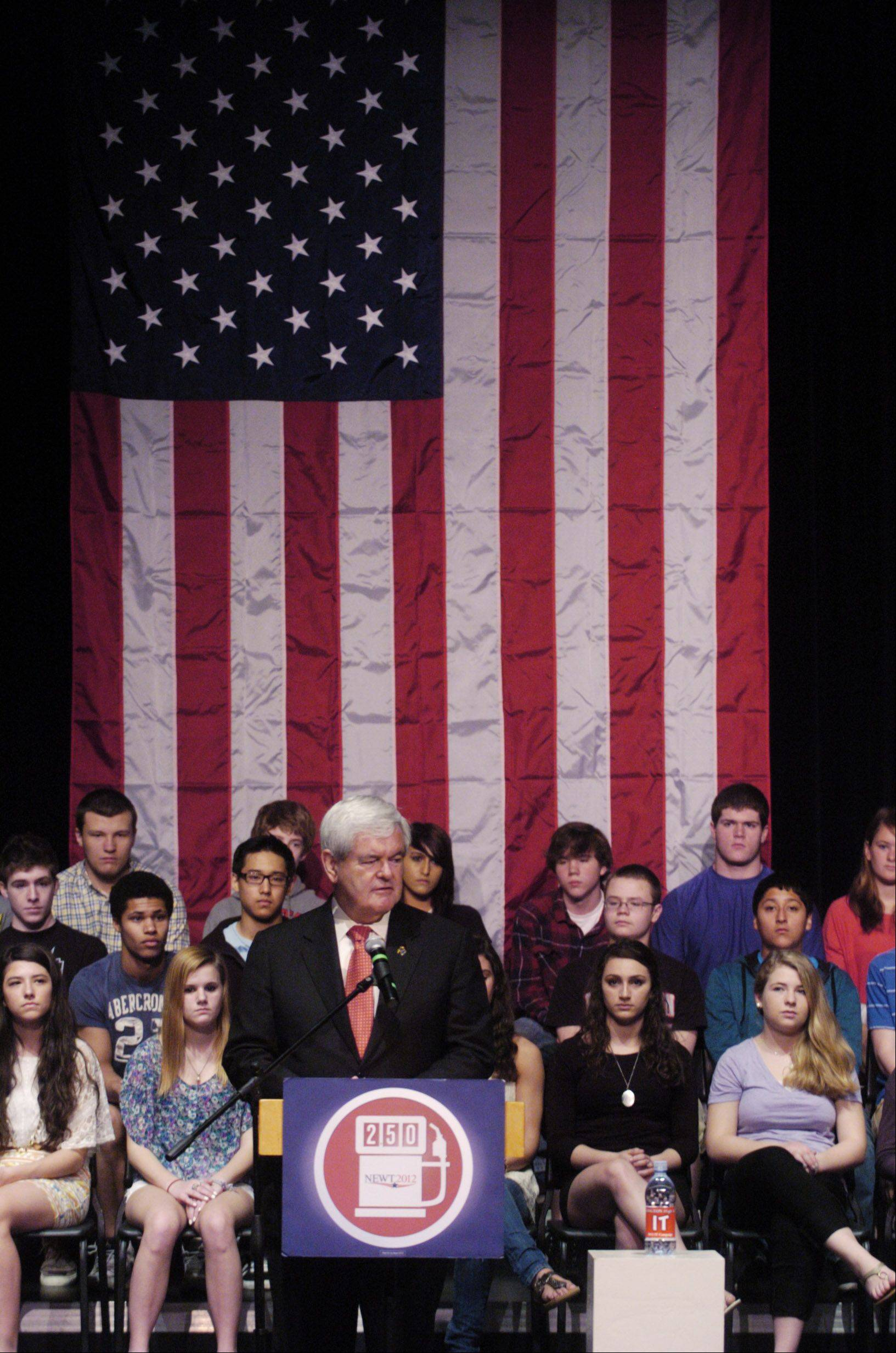 Republican presidential candidate Newt Gingrich opened a day of campaigning around the suburbs Thursday with a speech at Barrington High School.