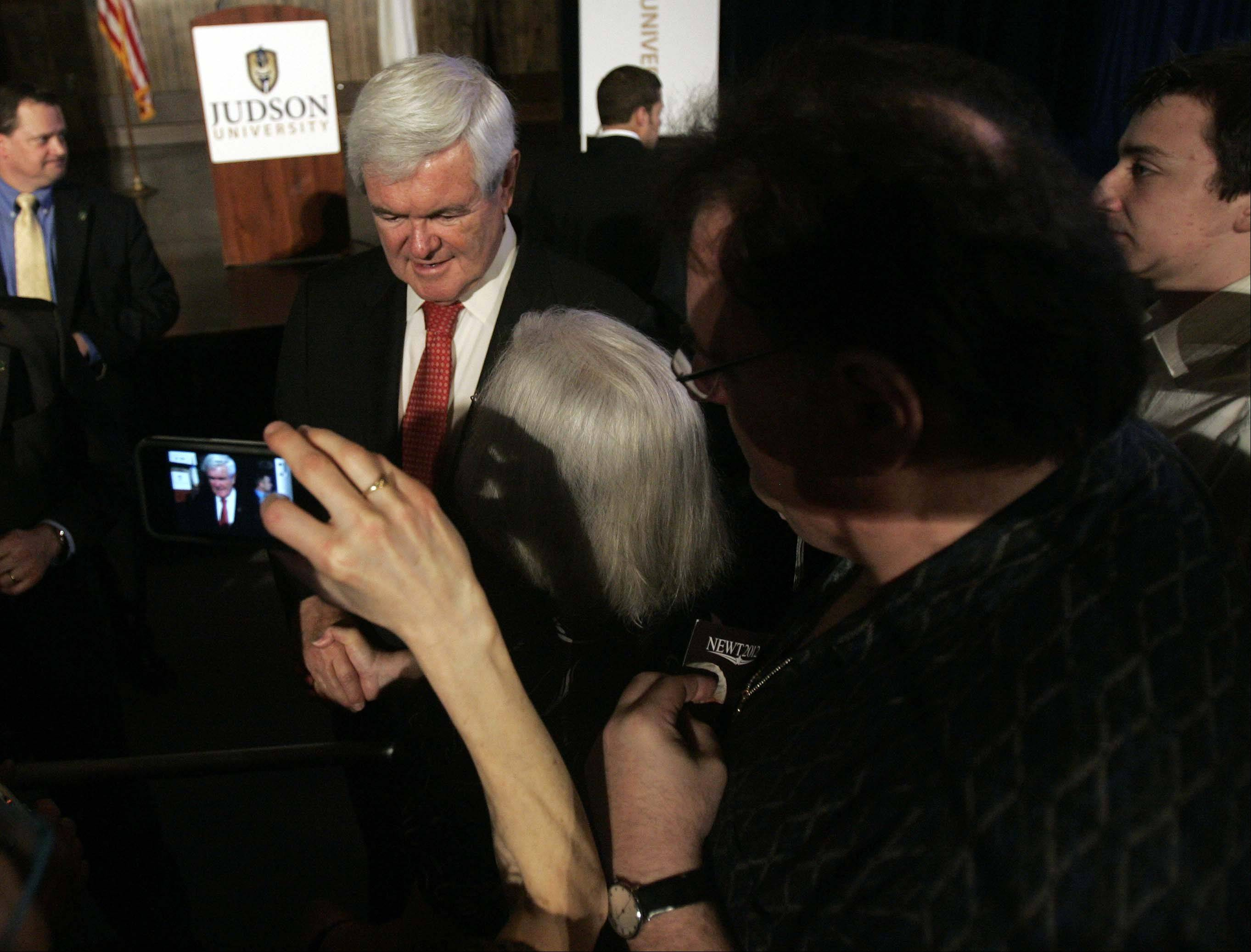 Republican presidential hopeful Newt Gingrich takes some time to meet the crowd at Herrick Chapel at Judson University in Elgin Thursday.