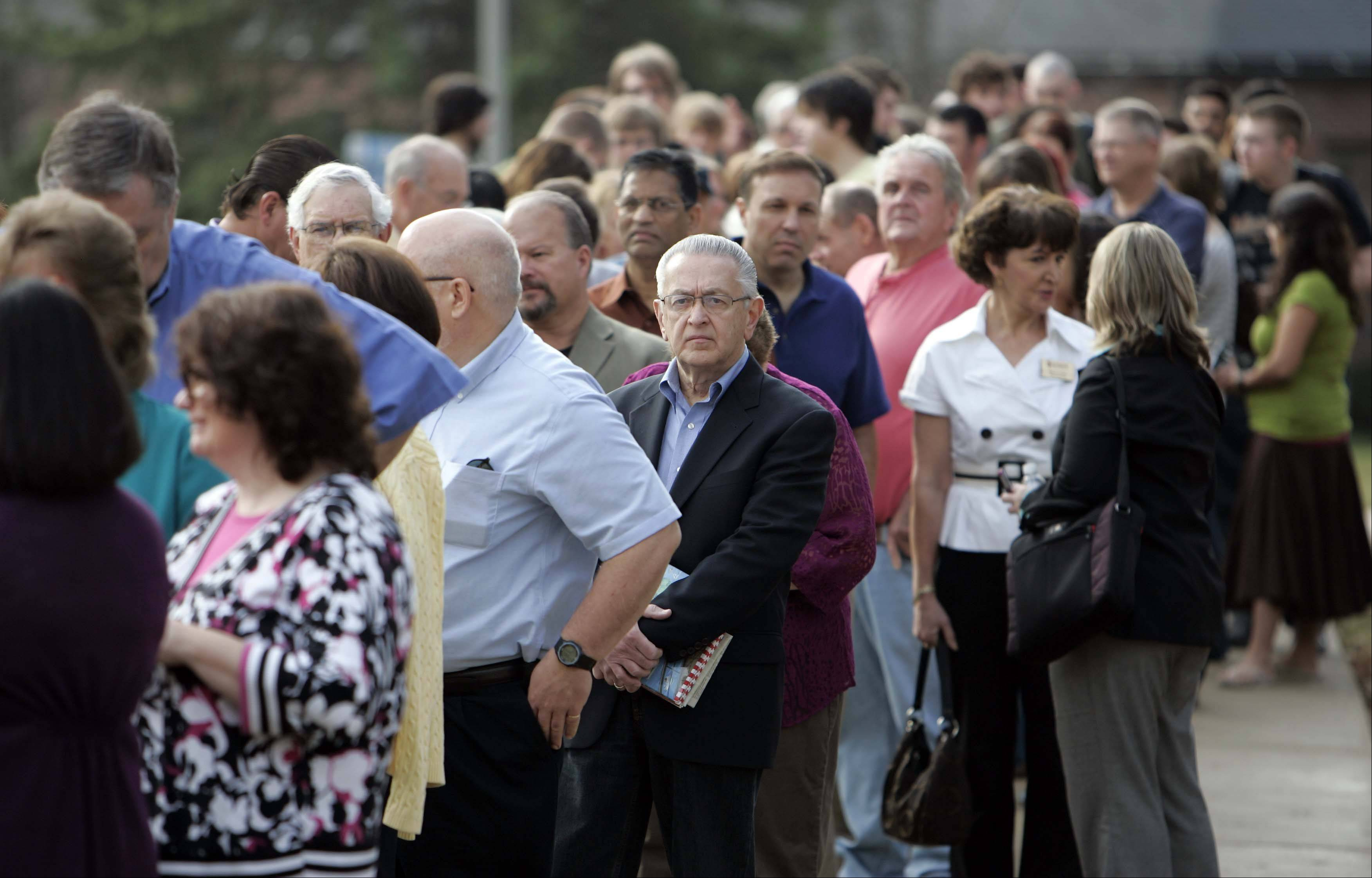 A crowd lines up to see GOP presidential hopeful Newt Gingrich speak at Herrick Chapel at Judson University in Elgin Thursday.