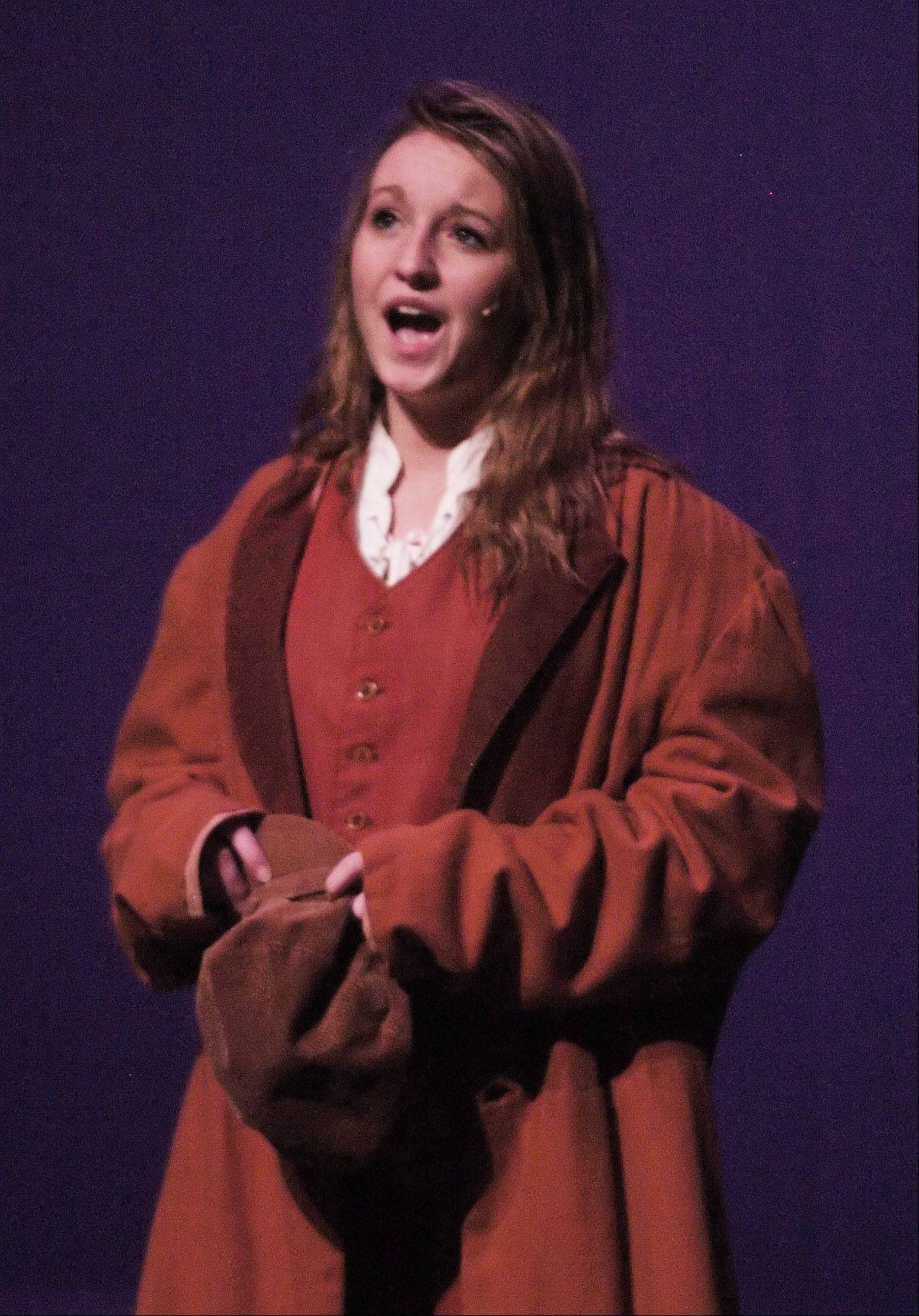 "Jordyn Withey, who plays Eponine, sings during rehearsal Tuesday for ""Les Miserables"" at Kaneland High School. The musical will be performed Friday, Saturday and Sunday."